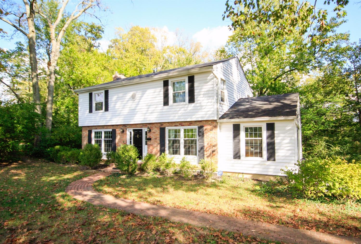 This Colonial Revival sits on 1.17 acres of heavy woods, a unique retreat on a private drive. 5 beds 2 full, 3 half bath. 1st fl master with adjoining full bath could be used as family room/study.  LL walkout with studio, reception area, bath.  New windows and exterior doors. Great private deck and patio area.