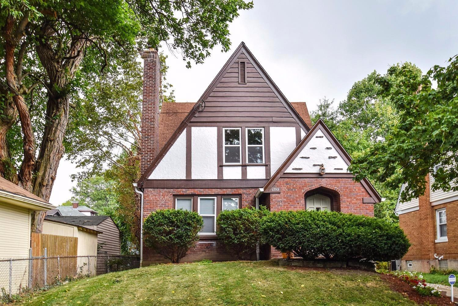 Elegant, beautifully updated 2345 SQ FT Tudor-style home on quiet side street! Hdwd flrs, neutral colors, new wdws thruout. New WOW kitchen w/stainless appl, granite counters, tile floor/backsplash. 2nd flr study can be a 6th BR by adding an armoire.  Waterproofed basement.    Attached + detached garages! Furnace '16, gutters '13. Home warranty!