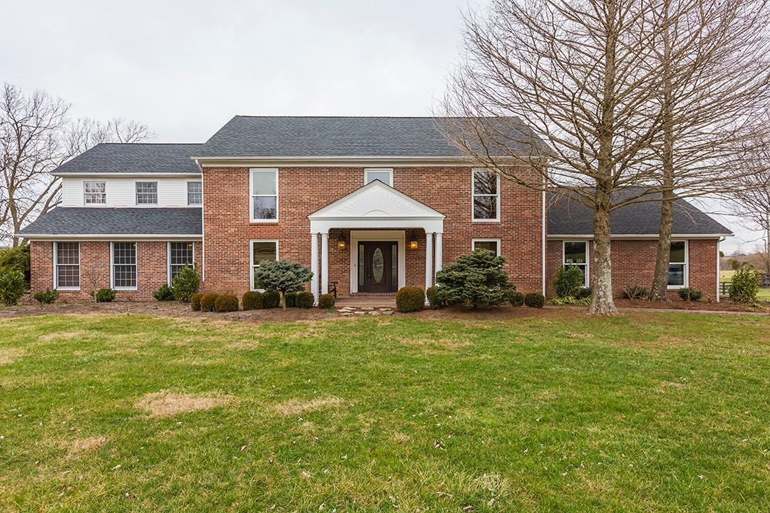 Stately%202-story%20brick%20home%20on%205%20acres%20minutes%20from%20Lexington.%20%20You%20may%20buy%20this%20home%20for%20the%20kitchen%20alone!%20%20Renovated%20kitchen%20is%20a%20chef's%20dream%20featuring:%20Butler's%20Pantry%20w/butcher%20block,%20glazed%20cabinetry,%20copper%20hood,%20Wolfe%20gas%20range,%20double%20ovens,%20warming%20drawer,%202%20islands,%20prep%20sink,%20granite,%20%202%20trash%20bins%20and%20the%20list%20goes%20on!%20%20Kitchen%20opens%20to%20Family%20room%20with%20built%20in%20bookshelves%20and%20fireplace%20w/gas%20logs.%20%20Master%20suite%20area%20is%20on%20the%20first%20level.%20%202nd%20level%20features%205%20bedrooms,%202%20full%20baths%20with%203rd%20bath%20roughed%20in,%20laundry%20area,%20and%20stairs%20to%20third%20level%20huge%20storage%20area.%20%20This%20home%20has%20extensive%20millwork,%20screened%20in%20vaulted%20deck,%20&%20patio.%20%2060x40%20barn%20with%20loft,%204%20stalls%20&%20storage%20(as-is),%20&%20paddock%20area.