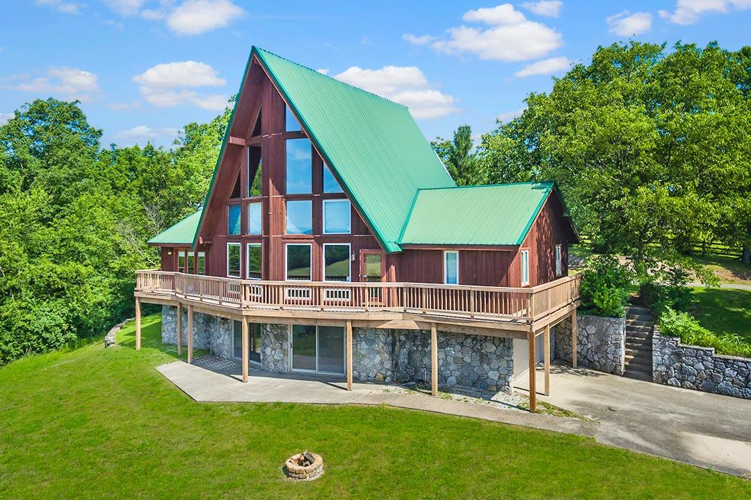 One%20of%20Berea,%20Kentucky's%20Most%20Special%20Properties!%20It%20can%20be%20yours...%208%20acres%20of%20privacy%20&%20million%20dollar%20views!%20Main%20level%20features%20a%20gorgeous%20updated%20kitchen%20w/solid%20surface%20counter%20tops,%20glass%20tiled%20back%20splash,%20pantry%20&%20tiled%20floors.%20Library%20was%20recently%20painted,%20see%20through%20fireplace%20&%20hardwood%20floors.%20Greatroom%20is%20nothing%20but%20breathtaking%20with%20fireplace,%202%20stories%20of%20recently%20replaced%20windows.%20Upstairs%20master%20ensuite%20w/walk%20in%20closet,%20remodeled%20bath%20w/2%20sinks%20&%20walk%20in%20shower.%20Lower%20level%20is%20complete%20w/2nd%20kitchenette%20space,%20full%20bathroom,%20office%20space,%20flex%20room,%204th%20bedroom%20(exterior%20door%20&%20no%20window),%20sauna%20room%20(sauna%20system%20removed%20but%20could%20be%20added%20back),%20family%20room%20w/fireplace%20w/stove%20insert%20&%20blower,%20wet%20bar%20w/copper%20counter%20top%20&%20refrigerator.%20Oversized%202%20car%20garage%20w/LOTS%20of%20extra%20storage!%20Home%20is%20connected%20to%20city%20sewer,%20there%20is%20also%20a%20buried/installed%20invisible%20pet%20fence,%20low%20maintenance%20metal%20fence,%20dual%20fuel%20heat%20pump%20system,%20&%20much%20more!