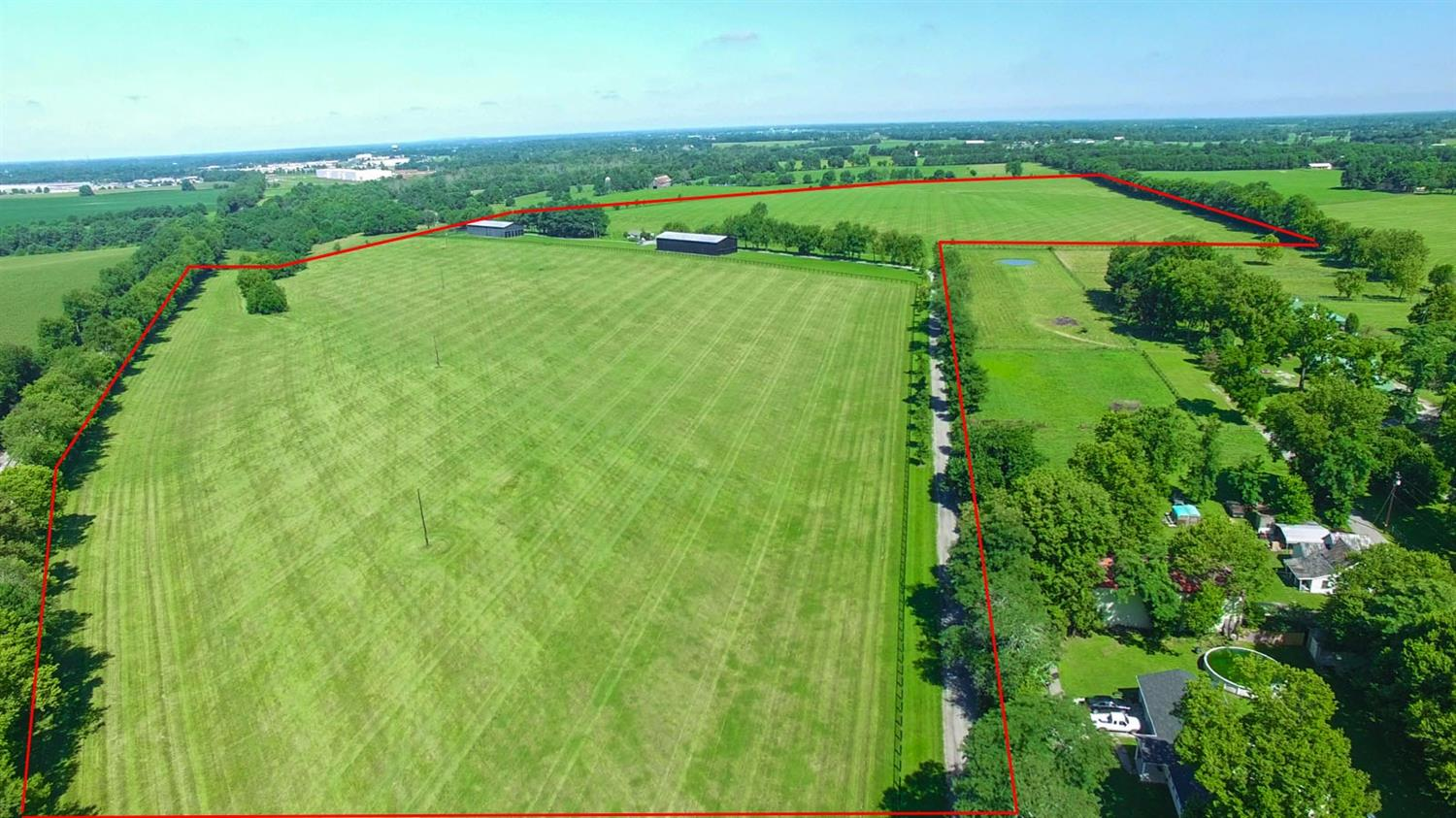 A%20hidden%2082%20acre%20gem%20in%20the%20middle%20of%20Woodford%20Co%20KY.%20This%20property%20has%20recently%20been%20completely%20refurbished%20and%20improved!%20Amenities%20include%20Two%20Large%20140x48%20Barns%20with%2014x16%20ft%20bents,%201285%20sqft%203%20bedroom%202%20bath%20modular%20residence,%20nearly%202%20miles%20of%20Diamond%20Mesh%20fencing,%20gated%20entrance%20with%20half%20mile%20of%20interior%20roadway,%20water%20lines%20and%20automatic%20mirafount%20waterers%20throughout,%20along%20with%20newly%20seeded%20grasses%20and%20fields.%20This%20property%20could%20be%20further%20developed%20to%20accommodate%20horses%20or%20is%20perfect%20for%20a%20well%20located%20estate.%20Located%20just%20off%20Versailles/Lexington%20road,%20the%20property%20is%20adjacent%20to%20and%20near%20Buck%20Pond%20Farm,%20Golden%20Age,%20Ashview,%20Cove%20Spring%20and%20WinStar%20Farms.