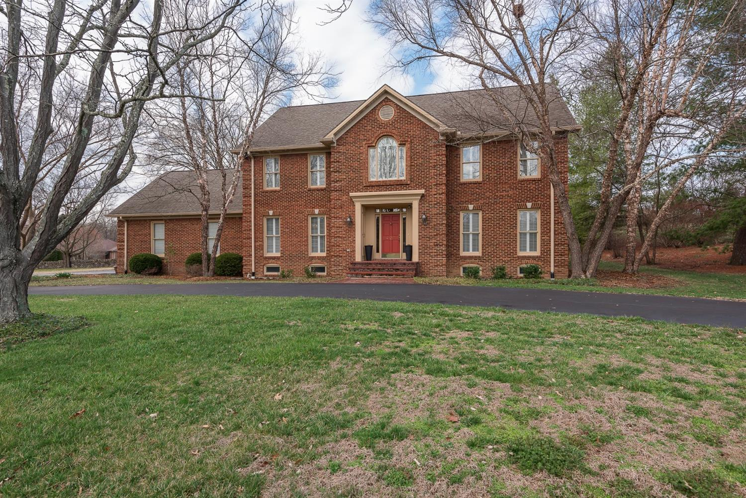 All-brick%204%20bedroom%20home%20with%20nearly%205,000%20sq%20ft,%20a%20basement,%20&%20a%20half%20acre%20lot.%20From%20the%20foyer's%20marble%20floors,%20to%20the%20stunning%20crown%20molding%20&%20custom%20features,%20this%20home%20will%20WOW%20you!%20Home%20has%20a%20large%20formal%20living%20room%20with%20wall-to-wall%20bookshelves%20&%20a%20gorgeous%20great%20room%20with%20a%20coffered%20ceiling,%20inviting%20fireplace,%20&%20direct%20access%20to%20the%20wonderful%20screened%20porch.%20Kitchen%20has%20custom%20cabinets,%20stainless%20steel%20appliances%20(including%20dual%20ovens%20&%20a%20surface%20unit)%20along%20w/%20a%20large%20island%20-%20adding%20even%20more%20counter%20&%20cabinet%20space.%20Spacious%20formal%20dining%20room%20with%20french%20doors%20makes%20entertaining%20easy.%20Large%20master%20suite%20features%20a%20separate%20sitting%20area%20&%20an%20enormous%20walk-in%20closet,%20along%20with%20an%20ensuite%20bathroom%20with%20separate%20whirlpool%20tub%20&%20shower.%203%20additional%20bedrooms%20are%20a%20good%20size.%20Basement%20has%20large%20rec%20room,%20a%20bonus%20room,%20&%20a%20kitchenette,%20along%20with%20tons%20of%20storage%20space.%20Love%20being%20outdoors?%20From%20the%20screened%20porch,%20step%20out%20onto%20the%20oversized%20patio%20&%20relax.%20This%20home%20has%20it%20all!
