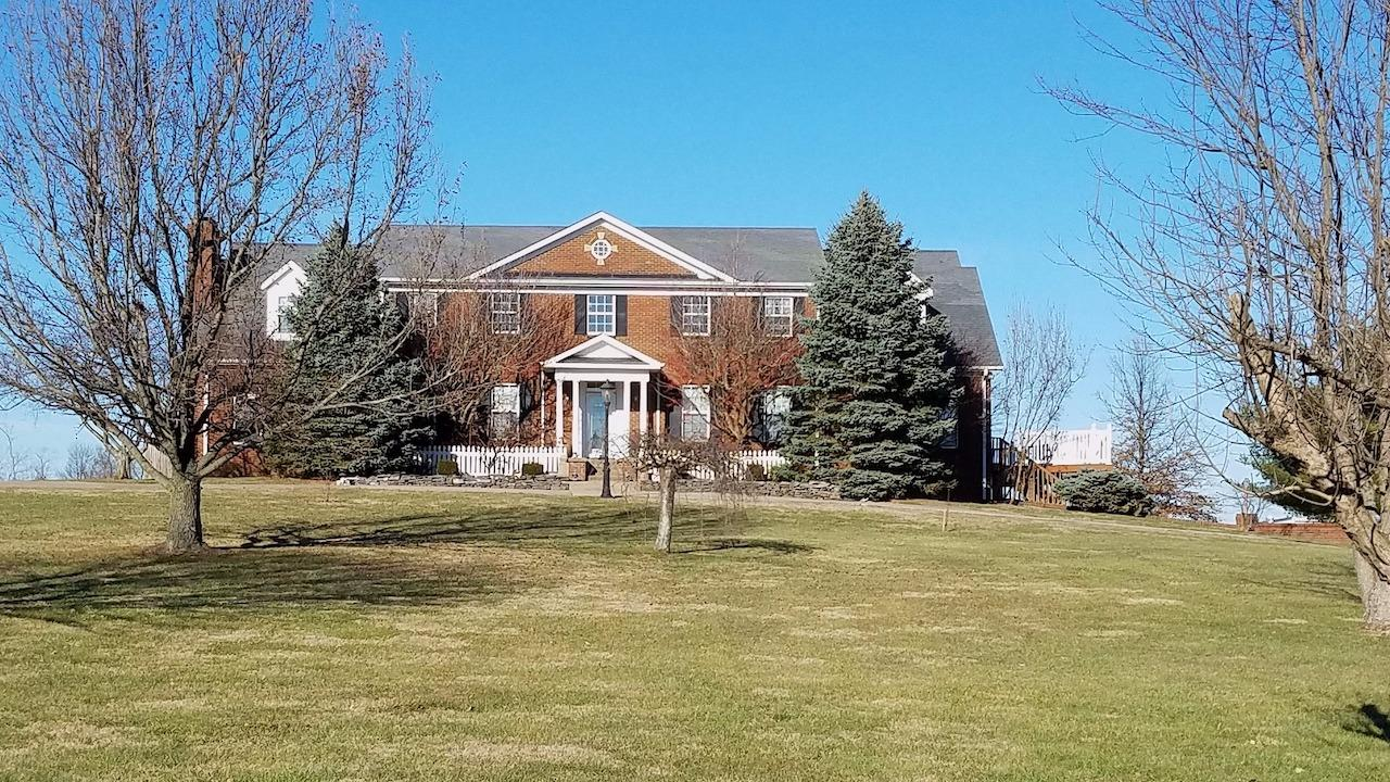 Elegant%20executive%20home%20on%2010%20acres%20in%20the%20heart%20of%20Boyle%20County%20only%20minutes%20from%20Danville.%20%20%20%20A%20grand%20entry%20features%20a%202%20story%20foyer%20with%20marble%20floors%20and%20twin%20curved%20staircases.%20There%20is%20a%20large%20home%20office%20with%20nice%20finishes%20and%20access%20to%20the%20wrap%20around%20deck.%20There%20is%20a%20formal%20living%20room%20with%20a%20beautiful%20stone%20fireplace%20at%20the%20other%20side%20of%20the%20foyer.%20Other%20features%20include%20a%20kitchen%20with%20granite%20countertops%20and%20breakfast%20area%20overlooking%20the%20land.%20There%20is%20a%20large%20formal%20dining%20room%20with%20deck%20access.%20There%20is%20and%20enclosed%20porch%20and%20screened%20porch%20off%20the%20wrap%20around%20deck.%201st%20floor%20bedroom%20and%204%20additional%20bedrooms%20on%20the%20second%20floor.%20The%20master%20suite%20features%20a%20large%20bath%20with%20two%20walk%20in%20closets.%20%20There%20is%20a%20sitting%20room%20with%20second%20floor%20balcony%20access%20next%20to%20the%20master%20suite.%20There%20is%20a%20full%20finished%20walk%20out%20basement%20with%20a%20full%20kitchen,%20family%20room%20and%20much%20more.%20This%20is%20a%20unique%20and%20comfortable%20country%20estate%20with%20privacy,%20peace%20and%20quiet.%20Call%20to%20learn%20more.