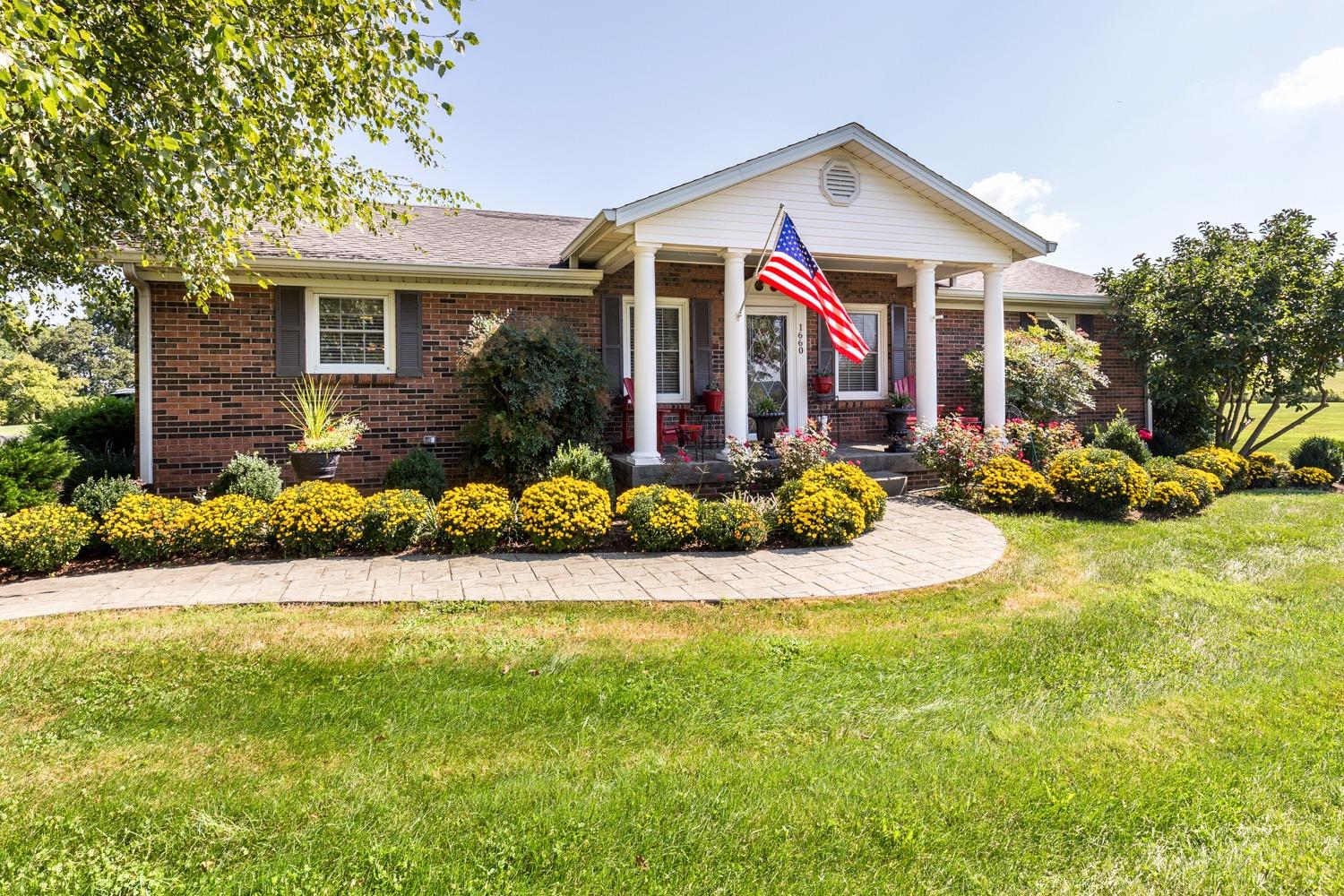 Only%2045%20minutes%20from%20Lexington,%20this%20updated%20brick%20ranch%20on%20a%20basement%20comes%20complete%20with%20an%20in-ground%20pool,%20apartment%20above%20heated%202-car%20garage,%20custom%20tree%20house,%20rustic%20cabin%20and%20a%20foam%20insulated,%20heated%20and%20cooled%20metal%20building%20complete%20with%20plumbing%20and%20offices%20(36%20x%2047).%20%20The%20pond%20is%20overstocked%20with%20large%20fish.