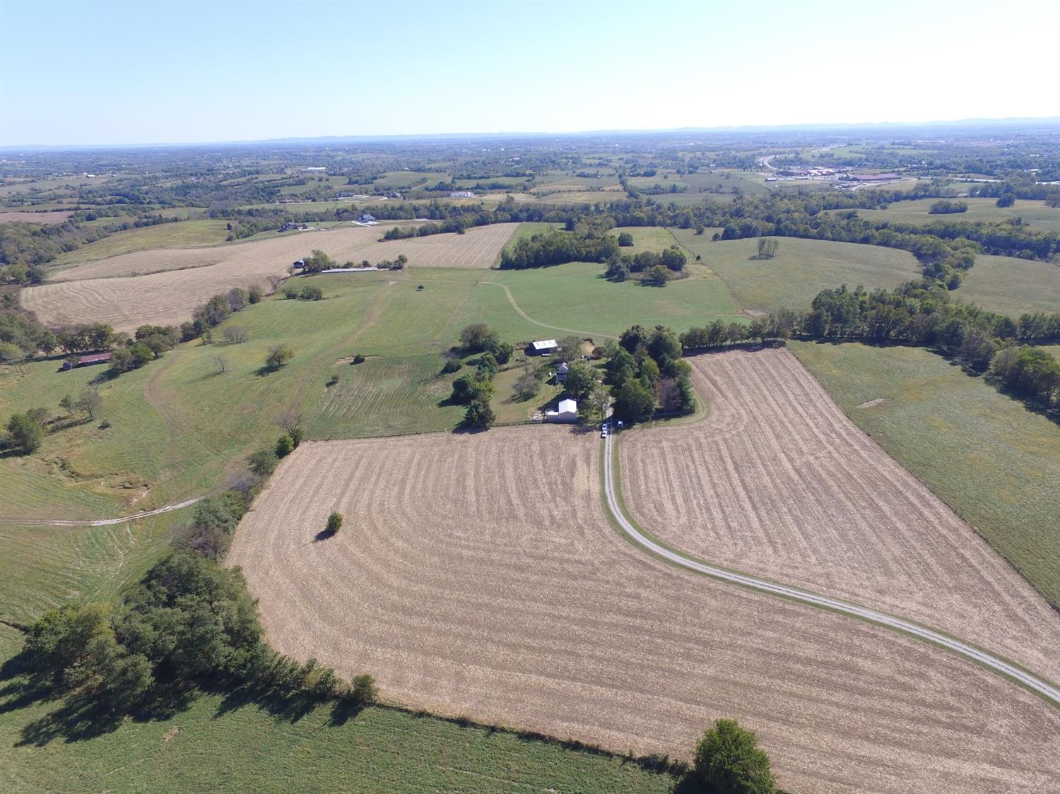 Remarkably%20rare%2015%20acre%20farm%20(part%20of%20McCord%20Farm)%20which%20has%20never%20been%20for%20sale%20before.%20Nestled%20in%20the%20trees%20surrounded%20by%20four%20board%20fencing%20with%20beautiful%20fields%20of%20corn,%20cattle,%20and%20beautiful%20green%20pastures%20is%20an%20enchanting%202%20story%20home%20with%20large%20front%20porch%20with%20columns%20that%20dates%20back%20to%201913%20and%20was%20a%20Sears%20&%20Roebuck%20four%20square%20house%20plan.%20An%20addition%20was%20added%20over%20the%20years%20for%20a%20large%20modern%20kitchen%20with%20an%20entire%20wall%20of%20windows%20which%20gave%20room%20above(upstairs)%20for%20a%20large%20master%20bedroom.%20Original%20stunning%20dark%20wide%20wood%20trim%20and%20interior%20solid%20dark%20wood%20doors.%20Home%20has%204%20bedrooms%20&%203%20baths,%207%20fireplaces,%20formal%20living%20and%20dining%20room,%20den%20and%20office.%20Property%20has%20a%20large%20barn,%20large%20metal%20building%20with%20bath%20room,%20fruit%20trees,%20partially%20fenced,%20and%20mature%20trees.%20An%20additional%2035%20acres%20can%20be%20bought%20for%20$250,000.