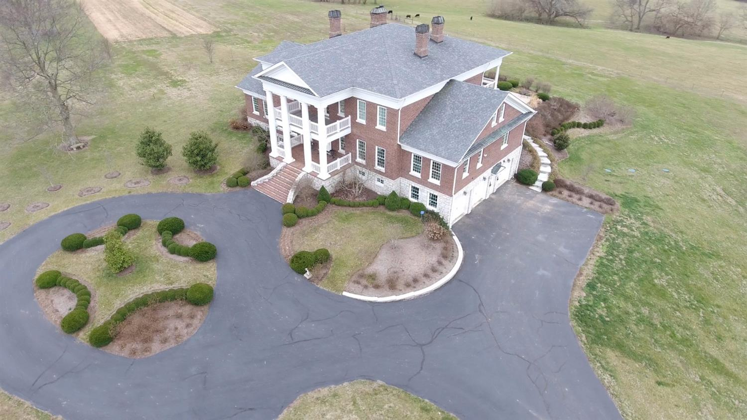 Beautiful%20home%20overlooking%20123+/-%20acres%20of%20bluegrass.%20%20Home%20was%20built%20in%202004%20with%20craftsmanship%20reminiscent%20of%20how%20homes%20should%20be%20built.%20%20Details,%20details.%20%20Full%20basement%20with%20recreation%20room,%20kitchen,%20%20fireplace,%20pool%20table%20and%20sauna.%20%20First%20floor%20has%20elegant%20but%20comfortable%20interior.%20First%20floor%20master%20has%20direct%20access%20to%20the%20covered%20porch%20overlooking%20the%20in%20ground%20pool.%20%20Family%20room%20has%20coffered%20ceilings%20and%20fireplace.%20%20Total%20of%205%20fireplaces.%20%20Lounging%20areas%20on%202nd%20floor%20landing%20and%20the%20lower%20level.%20%20Double-decker%20covered%20porches%20front%20and%20back.%20%20In-ground%20pool%20and%20hot%20tub%20with%20waterfall%20to%20the%20main%20pool%20with%20views%20for%20miles.%206%20bedrooms%206%20full%20baths%20and%203%20half%20baths.%20%20All%20bedrooms%20have%20en-suite%20baths.%20%206%20bent%20barn%20for%20equipment%20and%20storage.%20%205+/-%20acres%20for%20vineyards%20with%20approximately%202%20acres%20producing.%20%202-acre%20pond.%20%20Currently%20raising%20cattle.%20%20Lots%20of%20wildlife.%20%20Gently%20rolling%20fertile%20farmland.%20%20Well%20located%20in%20Woodford%20County%20Kentucky%20south%20of%20Versailles%20off%20of%20Troy%20Pike.