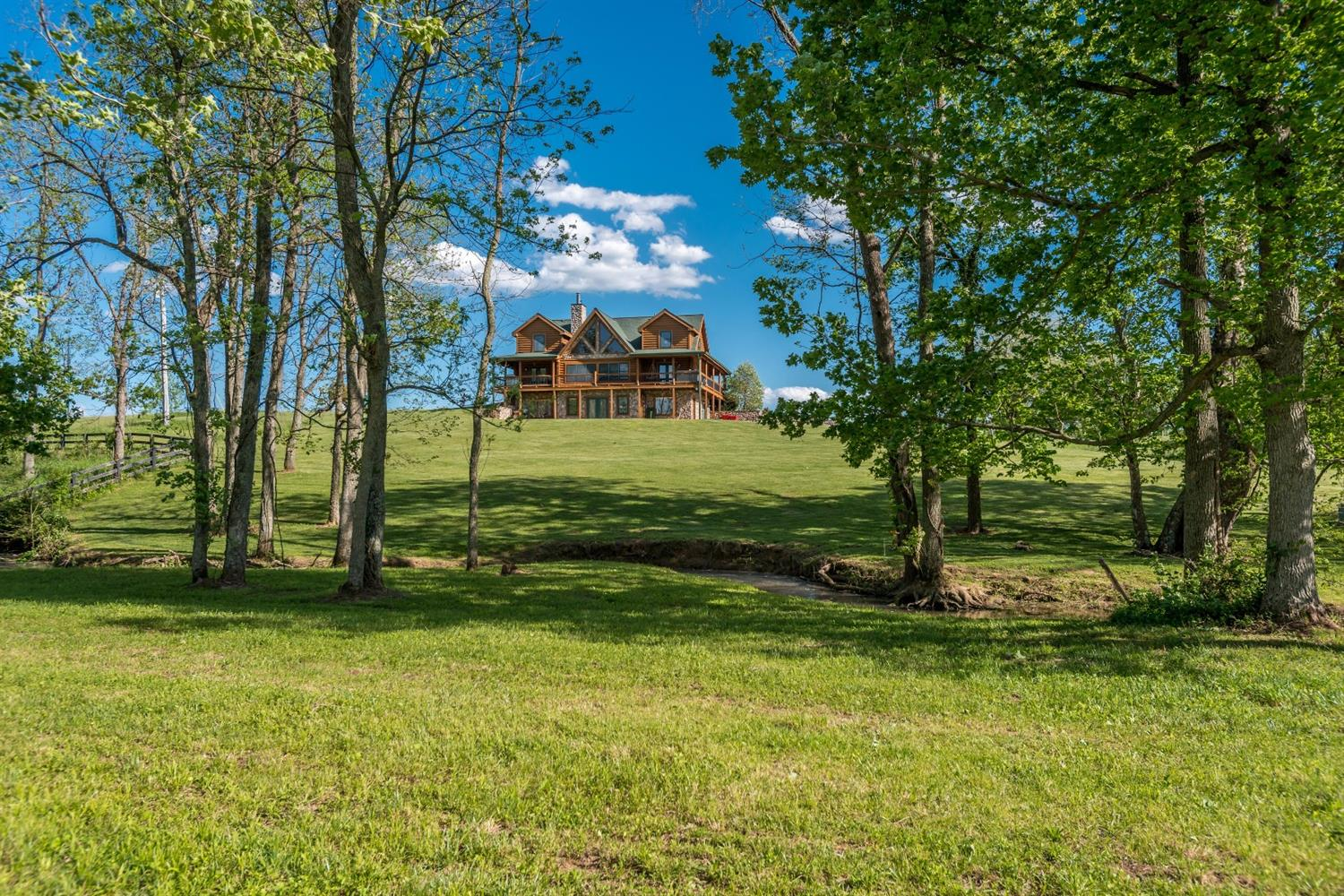 Plan%20your%20staycation%20in%20this%20gorgeous%20custom%20log%20home%20on%2015%20acres!%20Complete%20with%20extensive%20wrap%20around%20porches,%20gorgeous%20views%20of%20the%20gentle%20rolling%20pastures,%20pond,%20and%20stream,%20the%20outside%20is%20as%20inviting%20as%20the%20inside!%20The%20cracker-barrel-like%20stone%20fireplace%20is%20the%20centerpiece%20of%20this%20spectacular%20home!%20The%20geothermal%20system%20keeps%20it%20eco-friendly%20and%20economical!%20%20First%20floor%20master%20and%20utility%20room%20offers%20this%20floor%20plan%20versatility!%20A%20mother-in-law%20suite%20complete%20with%20kitchenette%20and%20fisher%20wood%20burning%20stove%20is%20accessible%20two%20ways%20in%20the%20walk%20out%20finished%20basement.%20All%20of%20this%20PLUS%20a%2052'%20x%2032'%20insulated%20shop%20with%20electric%20and%20water%20access%20and%2012'%20x%2052'%20wood%20shed!%20This%20Cabin%20has%20all%20the%20space%20you%20could%20need%20with%20a%20level%20of%20detail%20that%20you%20rarely%20find!%203%20miles%20from%20I-64%20puts%20you%20just%20minutes%20from%20Frankfort,%20Lexington,%20Louisville%20and%20Georgetown!!!