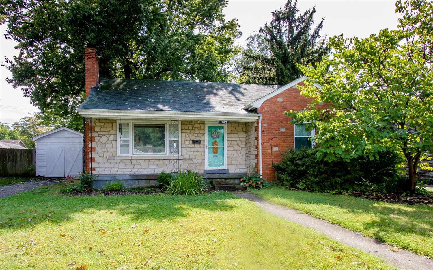 Step%20inside%20this%20charming%20home%20in%20the%20Southland%20area!%20The%20brick%20and%20cut%20stone%20curb%20appeal,%20hardwood%20floors%20and%20built-ins%20are%20perfection.%20This%203%20bedroom%20home%20is%20spacious%20downstairs%20and%20includes%20a%20large%20laundry%20area/%20mud%20room%20off%20the%20back%20entry.%20All%20plumbing%20and%20electrical%20have%20been%20updated%20by%20current%20owners.%20The%20kitchen%20has%20a%20new%20dishwasher,%20backsplash%20and%20countertops%20and%20is%20ready%20for%20you%20to%20choose%20the%20floors!%20%20The%20large,%20bright%20dining%20room%20has%20a%20built-in%20China%20cabinet%20with%20a%20top%20glass%20display%20and%20large%20storage%20area%20underneath.%20Big%20bedrooms%20and%20a%20large%20living%20room%20ensure%20plenty%20of%20space%20to%20stay%20warm%20on%20a%20fall%20evening.%20In%20the%20newly%20carpeted%20upstairs%20you%20will%20find%20another%20bedroom%20and%20a%20bonus%20room%20that%20could%20easily%20be%20a%204th%20bedroom.%20The%20outdoor%20space%20is%20amazing,%20too!%20The%20backyard%20is%20quiet%20and%20shaded,%20while%20the%20front%20porch%20is%20the%20perfect%20place%20to%20sit%20and%20enjoy%20time%20at%20your%20new%20home!%20Home%20warranty%20included%20for%20the%20new%20owners!