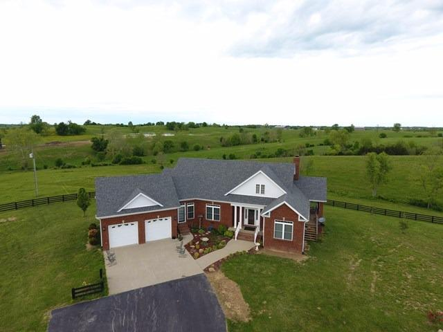 Gorgeous%20Brick%20one-story%20home%20with%20finished%20walk-out%20basement%20and%20sitting%20on%2016.682%20acres%20of%20prime%20scenic%20farmland!%20This%20custom-built%20home%20features%203%20bedrooms,%203%20baths,%20great%20room%20w/fireplace,%20family%20room%20w/fireplace.%20formal%20dining%20area,%20spacious%20custom%20kitchen%20w/breakfast%20area%20plus%20screened%20in%20porch%20overlooking%20the%20fields!%206%20bent%20barn%20and%20plank%20fencing%20makes%20it%20perfect%20for%20horses%20or%20cattle.%20A%20beautiful%20home%20with%20lots%20of%20extras!