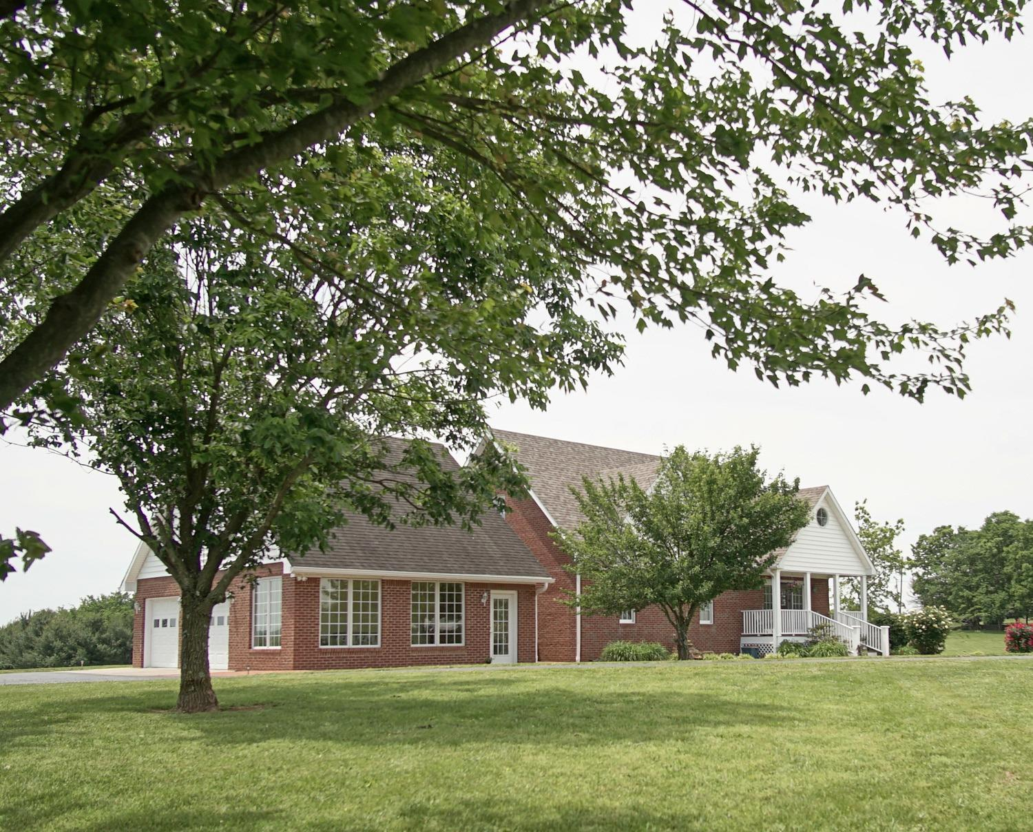 Searching%20for%20that%20special%20home%20with%20an%20in%20the%20country%20feel%20close%20to%20town?%20This%20brick%20home%20sits%20on%20a%20gorgeous%206.3%20acre%20tract%20of%20land.%20Its%20a%20premium%20location%20in%20Boyle%20County.%20This%20property%20has%20the%20feel%20of%20being%20miles%20out%20of%20town%20but%20is%20very%20close%20to%20everything.%20Near%20golf%20courses,%20Stores,%20and%20any%20other%20convenience%20you%20would%20expect%20if%20you%20were%20living%20in%20town.%20You%20will%20love%20the%20amazing%20views%20and%20sunsets%20as%20you%20look%20out%20over%20the%20beautiful%20Central%20Kentucky%20countryside.%20There%20is%20a%20wonderful%20stone%20fence%20meticulously%20restored%20by%20the%20owner.%20A%20large%20Garage/Workshop%20is%20perfectly%20situated%20on%20the%20property%20and%20features%20a%20wrap%20around%20porch.%20Enjoy%20the%20views%20and%20tranquility%20of%20the%20location%20from%20the%20covered%20deck,%20back%20porch%20and%20%20sunrise%20room''%20specifically%20designed%20to%20enjoy%20the%20sunrise%20year%20round!%20Other%20features%20include%20a%20unique%20layout%20with%20three%20bedrooms%20and%20three%20bathrooms,%20as%20well%20a%20finished%20partial%20walkout%20basement%20with%20a%20patio.%20Call%20today%20to%20learn%20more%20about%20this%20wonderful%20property!
