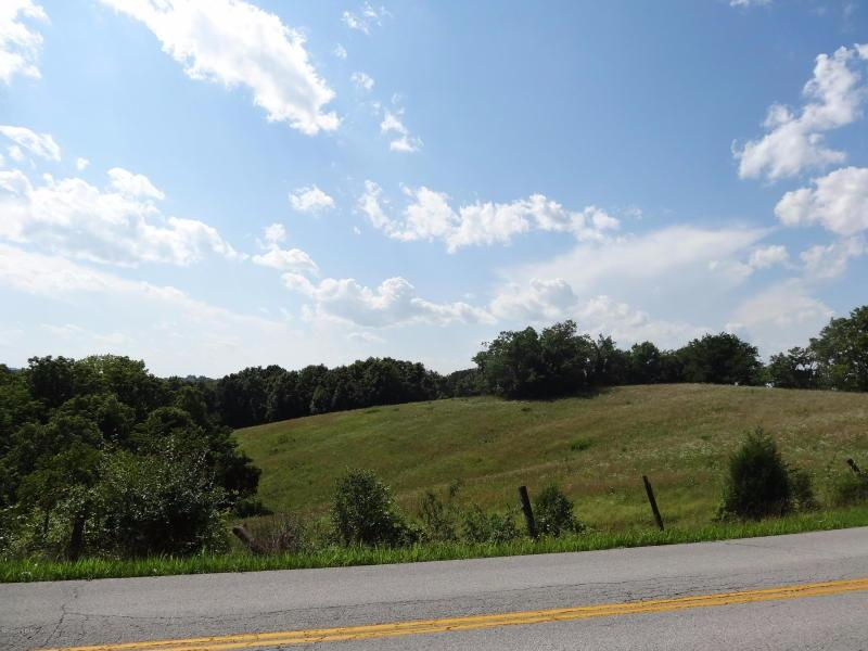 Beautiful%2021%20acres%20of%20land%20with%20road%20frontage%20on%202%20roads.%20Can%20easily%20be%20divided%20into%20several%20tracts%20if%20looking%20for%20a%20family.%20Nice%20open%20ridges%20and%20great%20places%20to%20build.%20Also%20woods%20for%20hunting.%20Sold%20As%20Is,%20This%20will%20need%20to%20be%20closed%20at%20the%20same%20time%20as%20property%20across%20the%20road.