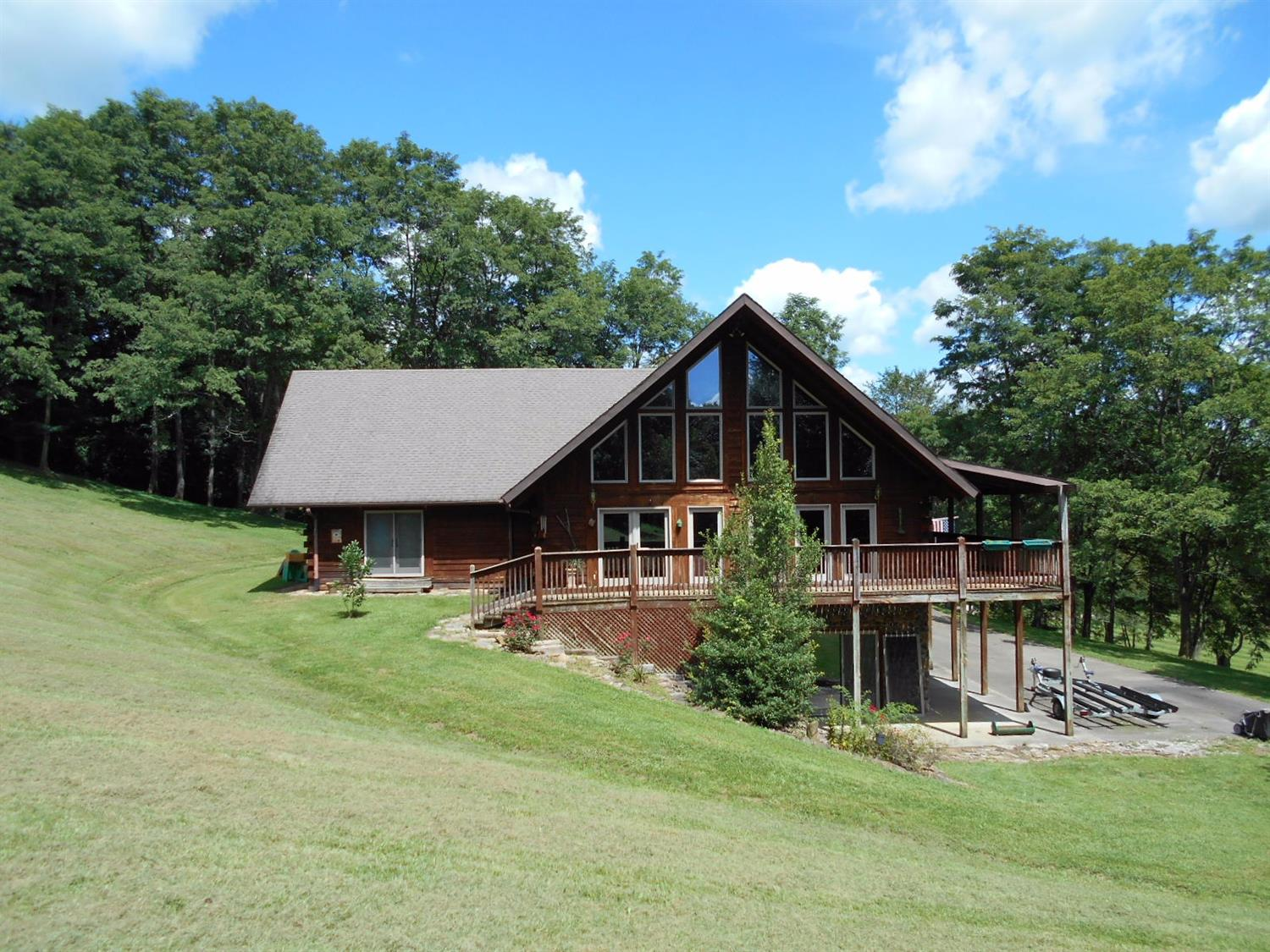 Looking for private country living close to everything? Only 25 miles east of Lexington; 2 miles west of Mt.Sterling on US 60, this 17+acres with a 30x60 metal building has potential for horses, organic farming or other unique interests.   The impressive custom built log home with wrap around covered porch has 4700 sq ft of open living area and a 2680 sq ft partially finished basement with high, 15ft ceilings. Built to be environmentally friendly, the home was engineered with passive solar design and passive geothermal heating and cooling. The spacious kitchen is ready to host family or entertain with custom cherry cabinets, two sinks, and large island with seating for 8.  The Master suite, located on the main floor, has two exterior exits and an en-suite bathroom with large custom tiled shower. The large 2048 sq ft upstairs loft opens onto large deck. This home also boasts a 2 car garage in the lower level and a 2 car carport on the main living level providing both access and storage,