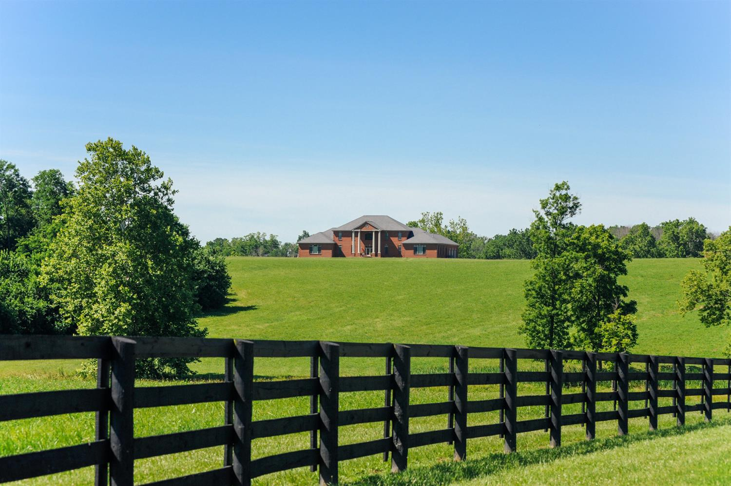 Fantastic%20opportunity%20to%20own%20an%20extraordinary%20custom%20home%20in%20the%20heart%20of%20the%20Bluegrass!%20This%20traditional%20Kentucky%20Manor%20home%20boasts%20over%209,000%20sqft%20of%20finished%20living%20space%20and%204,000%20sqft%20of%20partially%20finished%20below%20grade%20space.%20The%20first%20floor%20conveniently%20features%20a%20grand%20master%20suite,%20complete%20with%20a%20fireplace,%20oversized%20walk-in%20closets%20and%20huge%20master%20bath%20with%20shower%20&%20Jacuzzi%20tub.%20%20No%20expense%20was%20spared%20in%20the%20gourmet%20kitchen.%20Complete%20with%204%20dishwashers,%20top%20of%20the%20line%20gas%20stove%20and%20ovens,%20granite%20counter%20tops%20throughout.%20Each%20floor%20conveniently%20features%20its%20own%20laundry%20space.%20Stunning%20sunset%20views%20off%20the%20back%20patio%20overlooking%20lush%20pastures.%20All%20bedrooms%20have%20an%20en%20suite%20bath.%20A%20blank%20canvas%20of%20137%20rolling%20acres%20awaits%20to%20build%20the%20horse%20property%20of%20your%20dreams.%20%20A%20high%20powered%20well,%20along%20with%20KU%20electric%20is%20in%20place%20toward%20the%20back%20of%20the%20property.%20Very%20private%20yet%20just%20a%20short%20drive%20into%20the%20heart%20of%20Lexington.