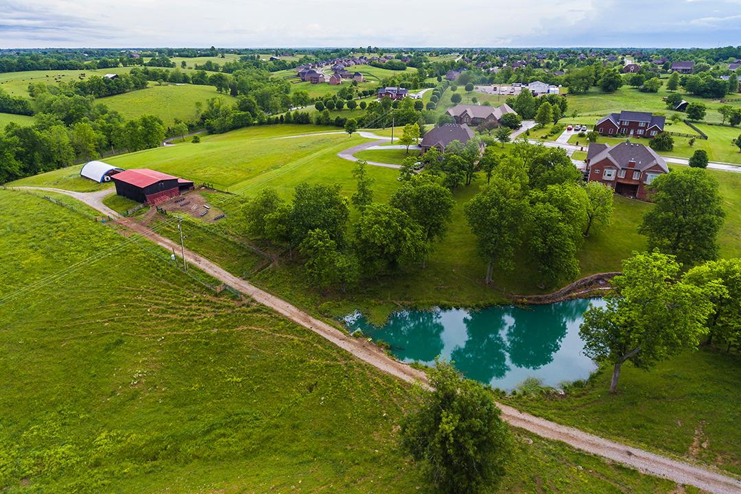Farm%20consists%20of%20a%208%20bent%20barn%20with%20a%20large%20workshop%20with%20a%20concrete%20floor.%20Good%20size%20pond,%20water%20spigot(all%20weather)and%20an%20automatic%20waterer.%20Hay%20storage%20structure%20will%20hold%20100%20rolls%20of%20hay.%20%20Farm%20currently%20used%20as%20a%20cattle%20farm.%20Excellent%20building%20site%20on%20top,%20barn%20also%20has%20an%20attached%20large%20shed%20for%20cattle%20feeding%20or%20equipment%20shelter.