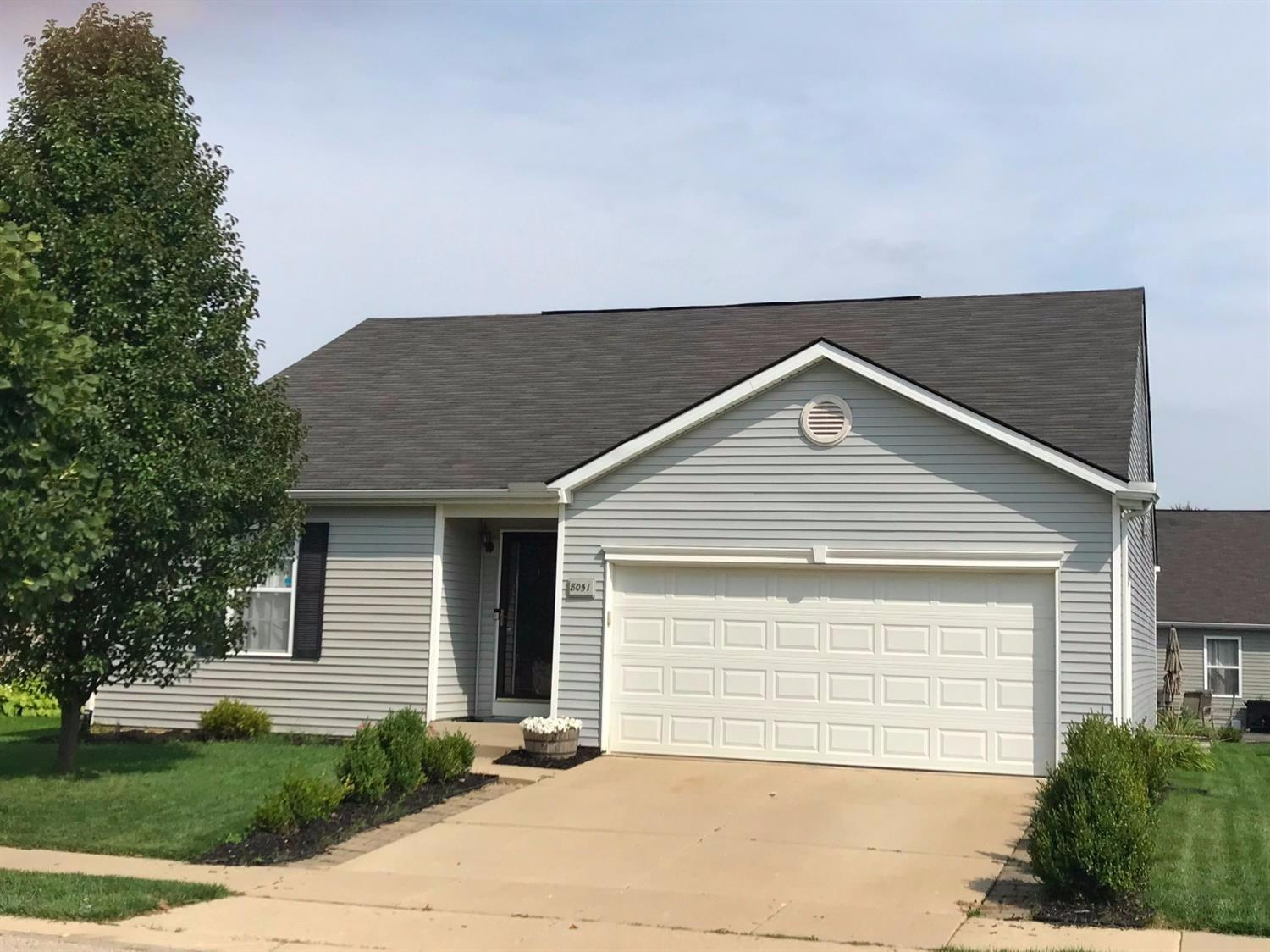 Front of home with mature landscaping