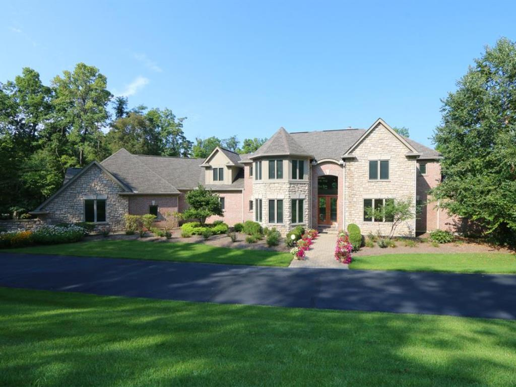 Privacy abounds! Pristine transitional home on 3 acres at end of priv dr. Only 14 yrs old! 2-story entry w/marble & hrdwd/open to great rm w/walls of windows overlooking pool. Fab kit w/lux applia/open to brkfst & fam rms. 1st flr master ste. 4 BRs up w/2 Jack n Jill BAs. Walk-out LL w/10 ft ceilings/kitchenette/BR+BA/theater. Pool & wood views!