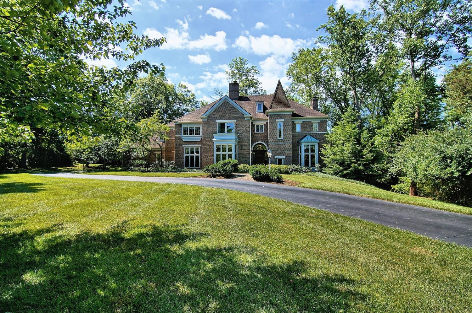 Majestic Chateau style home in sought after Coldstream neighborhood. Superior finishes. Custom construction. Unique design. Amazing curb appeal. Multiple indoor/outdoor entertainment areas! Close to parks,entertainment,restaurants,shopping & highways. Serene Private 1 acre lot. Forest Hills Schools.