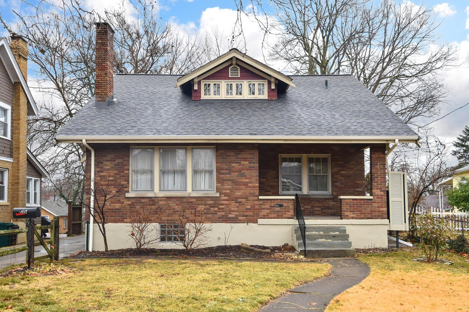 The charmer you have been looking for in Northside! Wood floors throughout, Rookwood fireplace & the natural woodwork exudes quaintness and character. Lots of closet space. Great backyard for entertaining.  Updated kitchen with SS appliances. New roof and gutters!  High efficiency furnace.