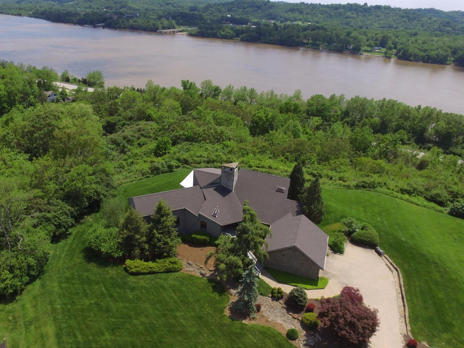 Panoramic river views from this breathtaking transitional home on amazingly private lawn - stunning stone fireplace - soaring ceilings - first floor master suite -  finished lower level - approx 6,000 + sf on 3 levels - a rare opportunity!