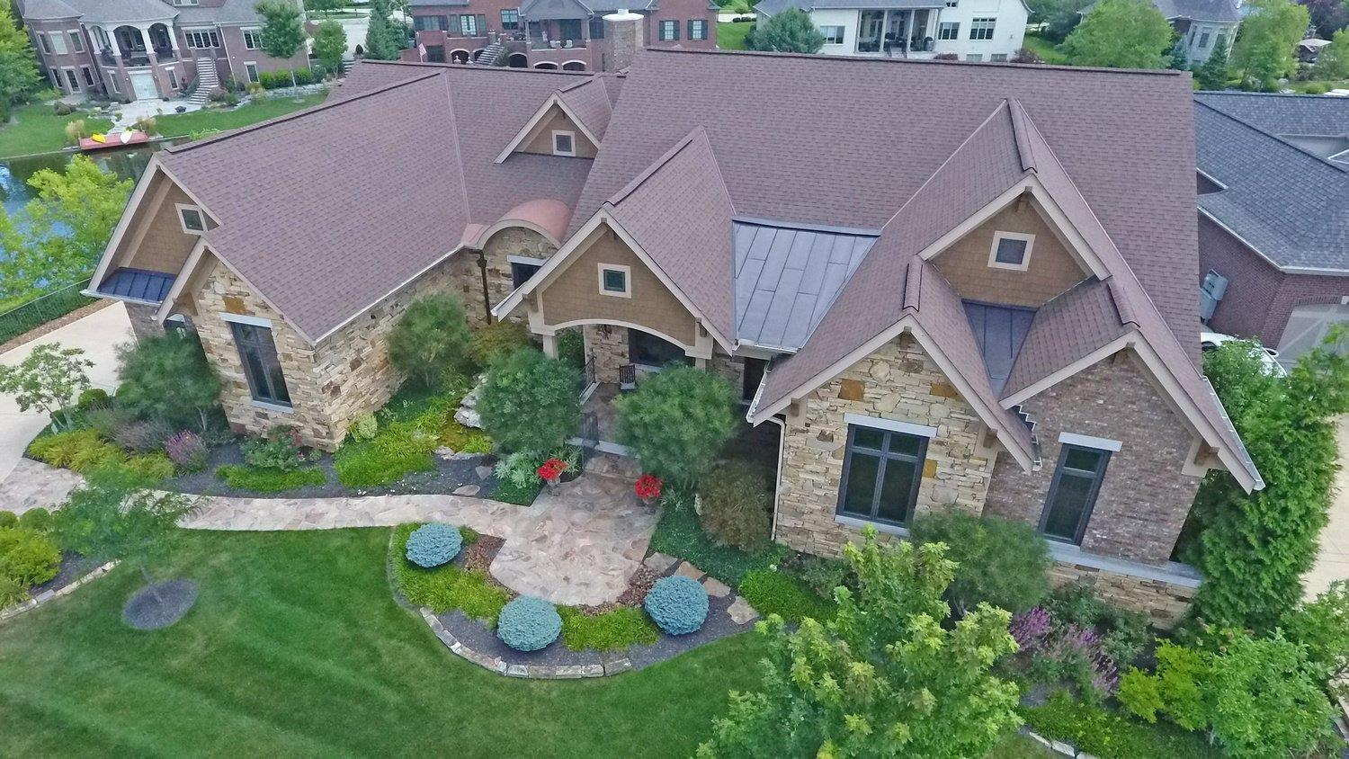Spectacular ranch style living w/amazing outdoor living & water views from every rm! Grt home for entertaining w/open flr pln. Lux 1st floor MA suite. Flex rm on first flr=bdrm/arts & crafts. Fin W/out LL w/3 bedrooms, studio, exer rm, large media & game rms. Prof landscaped w/LL water view platform. Covered & uncov patio w/fpl & grill/cooking area