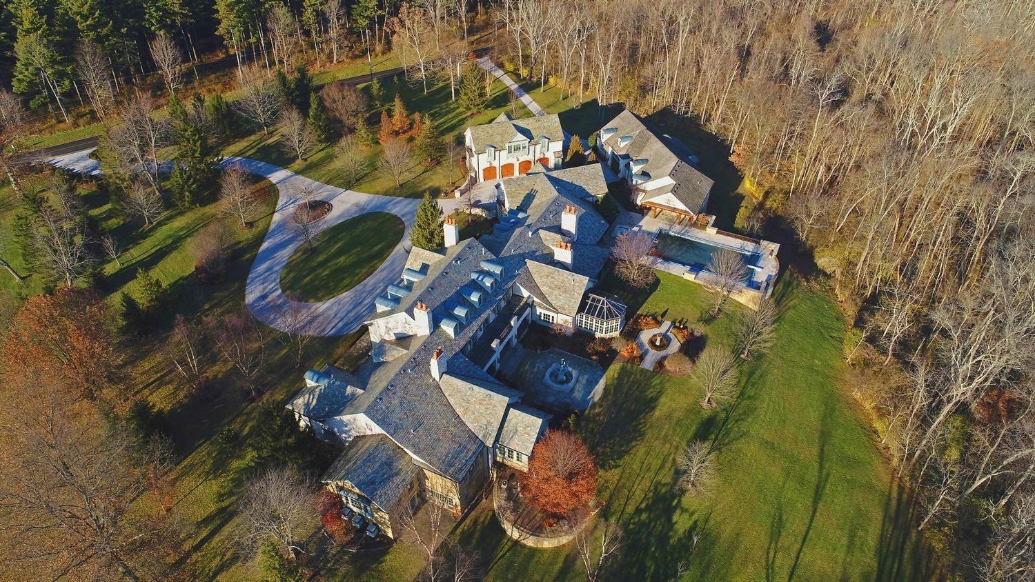 Incomparable 27,000 SF Chateau on 5+ acres surrounded by 300 acre forever greenbelt*Old-world plaster walls*Limestone & walnut floors*Hand-hewn beamed ceilings*Gourmet & catering KIT*5-room master suite*Conservatory*7 fireplaces*1000-bottle wine cellar*Theater*Game rm*Exercise studio*Library*2 carriage house apts*Pool w/pool house*25+ car garages.