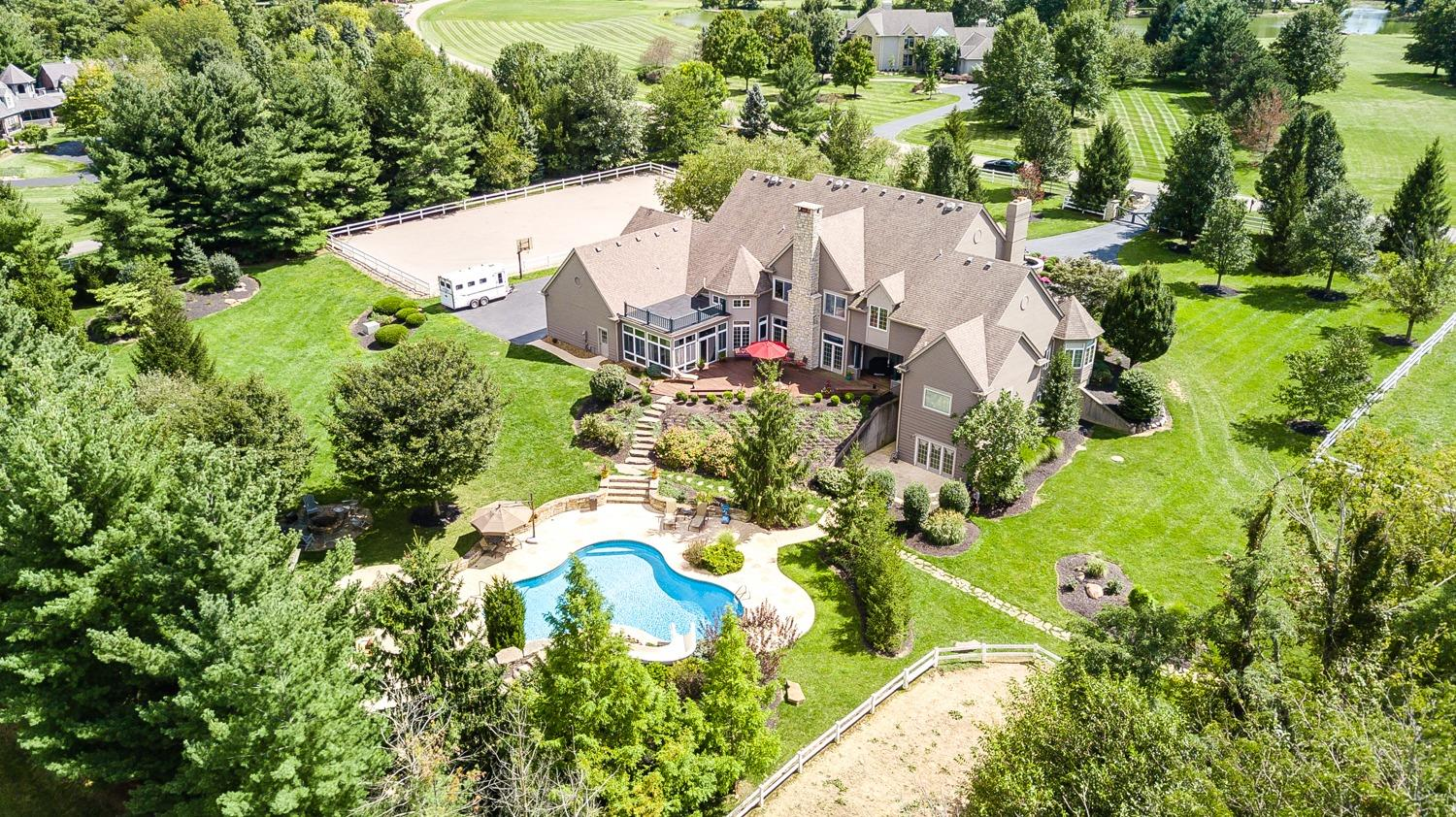 A rare opportunity! Enjoy 5+ acres w/benefits of a neighborhd! 6 BR/6+baths, lg kit w/bkfst rm, 16x21 scr porch, 1st flr mstr suite w/sitting rm, 2nd flr w/4+ BR, fully fin w/o LL w/rec rm, media rm, bar, exer rm. Vacation @home w/heated saltwater pool paradise. Rm for your horses w/barn/pasture/riding arena!     Fully fenced w/electric gated ent