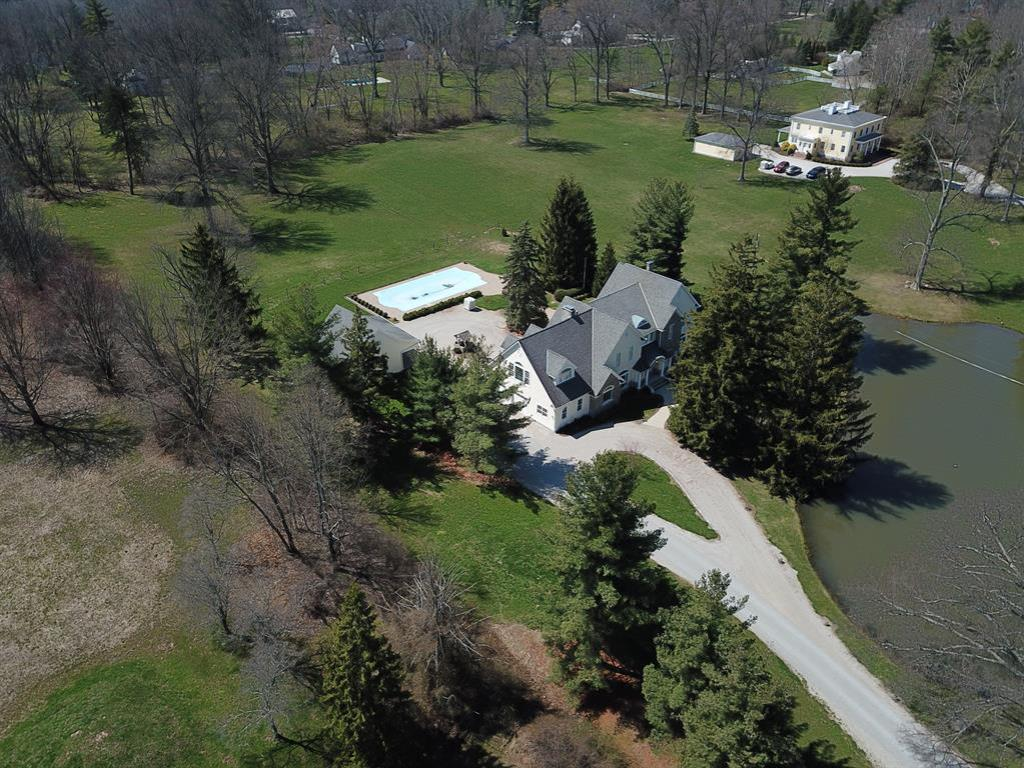 Classic Indian Hill Living. Expanded & Updated, this Farmhouse has everything today's buyer wants. 5700+ sq ft of top of the line amenities 4 Bed, 5 Full BA & 2nd flr Bonus rm*Exquisite kitchen*Large cozy Family rm*1st flr study*Elevator*Pond*Pool*4+ car gar plus 2 horse stalls*3.9ac Unique property