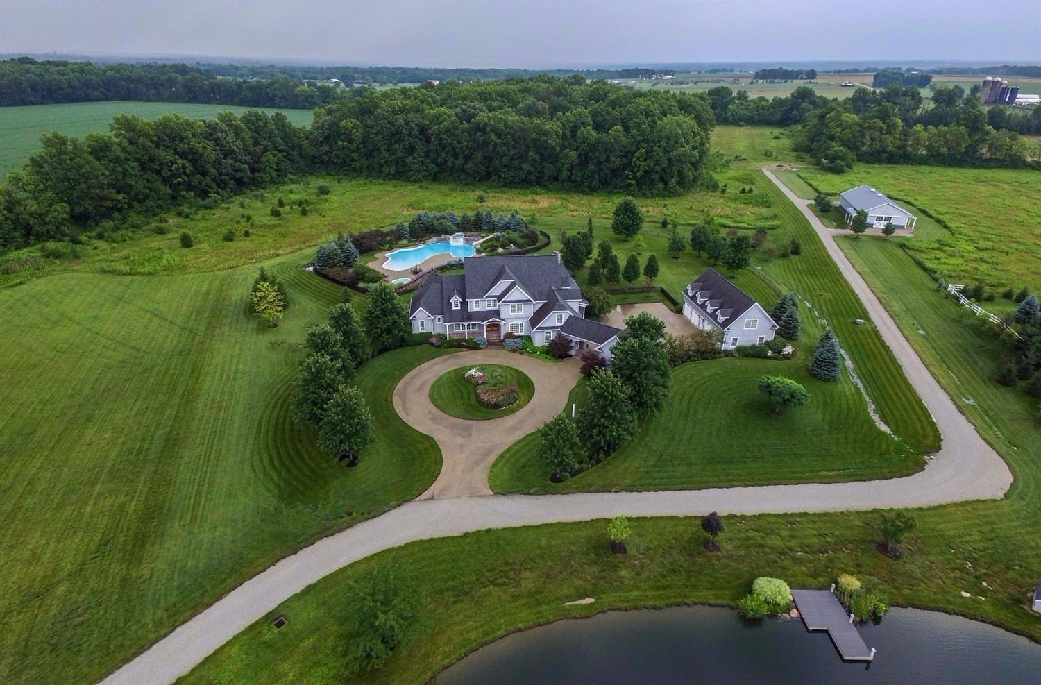 So much more than a home, this is a lifestyle! One-of-a-kind rural estate includes a stocked lake, resort-like pool, a 3-stall horse barn with loft and tack room, and 10,000 sqft of comfortable and easy living space. Beautiful architectural details and thoughtful design will impress you; the never-ending list of amenities will make you want to stay