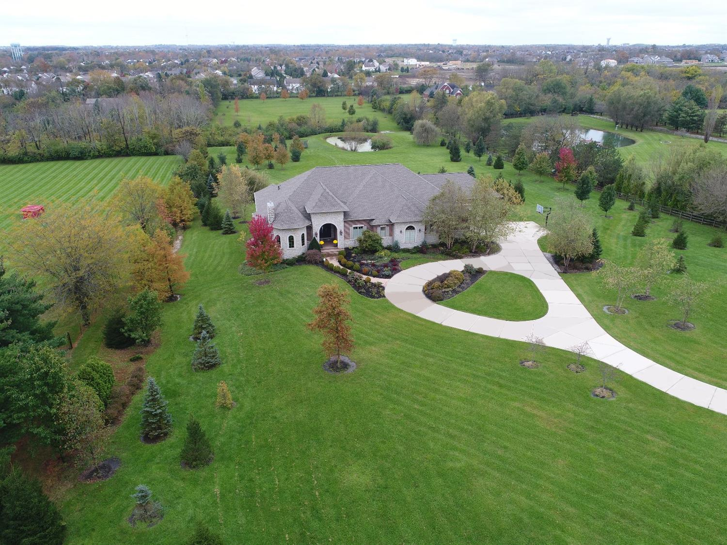 Rare Find in Mason! Amazing 8.8 Acre Oasis*Truly Custom Ranch Home with Lower Level above grade for walkout to desired upper & lower Outdoor Entertaining areas overlooking Lake*7303 SF*4 Car Oversized Garage*Hi End Finishes thru out & so much detail*Convenient to Hwy 75/71-Shops-Hosp-Restr*Offers an Amazing Value that could not be replicated today!