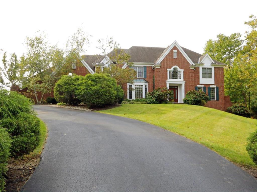 Gorgeous brick transitional home on culdesac. Privacy abounds. 6,300 sq ft per Auditor + finished LL*Two-story entry w/curvd stairs/marble flrs*Intricate moldings & detail*Spacious kit w/lrg granite island/2nd stairs*Great rm w/12 ft ceilings, adjacent solarium*All BRs w/en-suite BAs*Walk-out LL w/rec rm/media/bar/wine/BA*Lush yard w/fabulous pool!