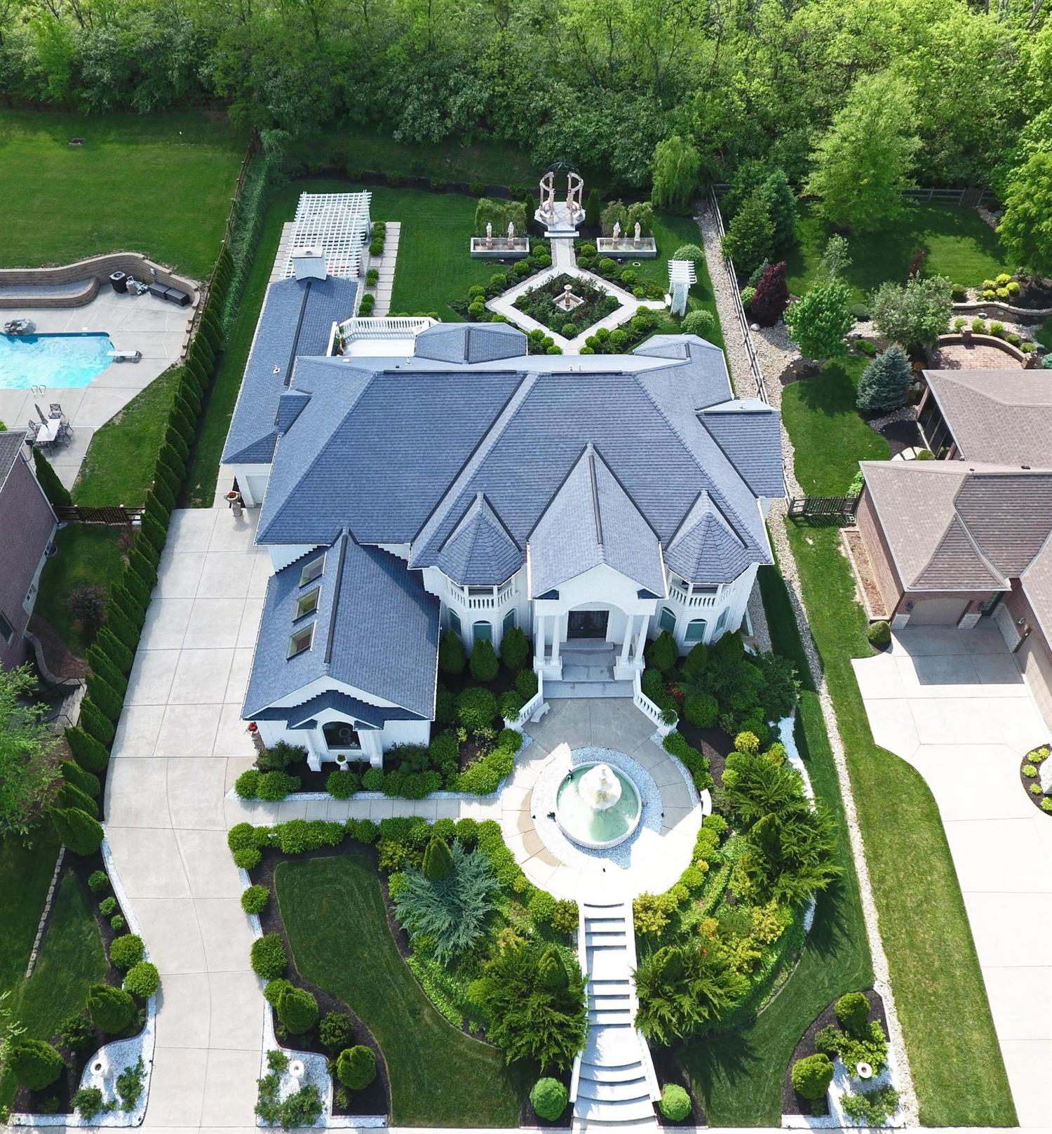 Luxuriously Majestic and Lavish Custom Home*6346 SqFt*5BD*6BA*Grand Entertaining and Family Living w/Formal Aristocratic Gardens*Lrg Custm Gour Kitch w/Hi-End Appl & Wlk-In Coolr*Mstr Ste w/Luxry BA & 2nd Fl Patio/Blcony*1st Fl Guest Ste*6 Fireplcs*Imprtd Custm Marble & Grnte Fnshs*Outdr Ktch/Cvrd Patio*Spa*4 Car Grg*Amazing Outdoor Entertaining!