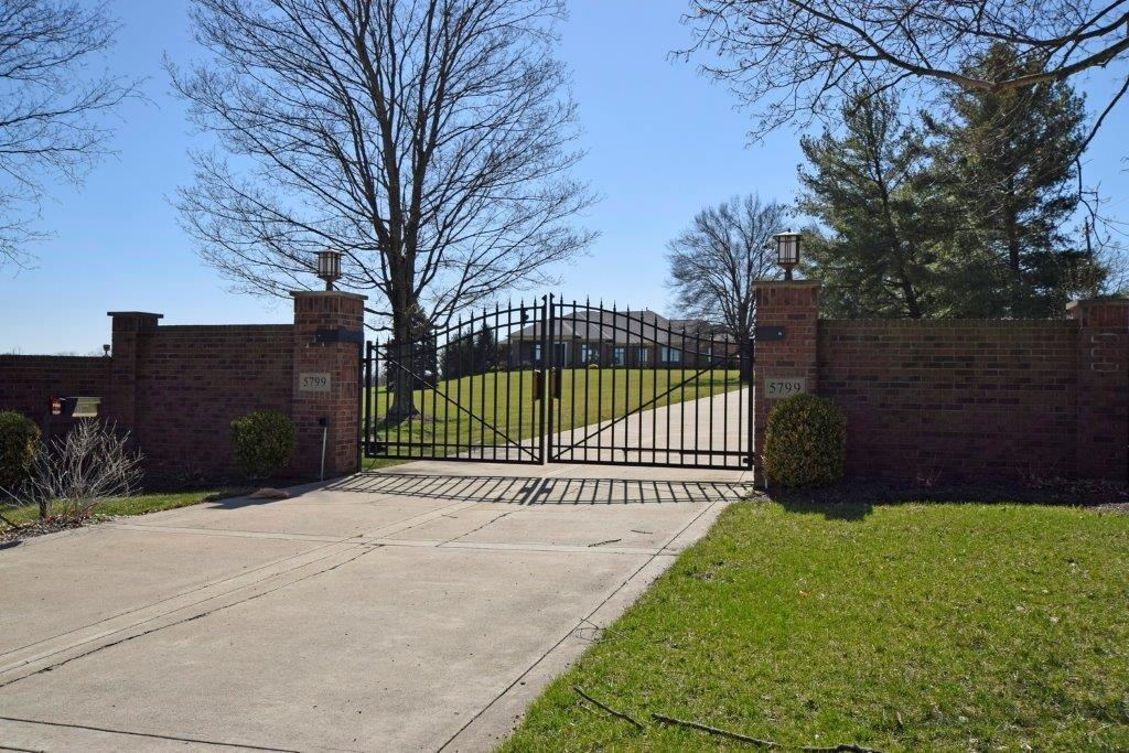 ONE of a KIND! Private Gated Estate Property situated on 10.9 Acres*Amazing Ranch w/HiEnd finishes throughout*10'+Clgs*Open Flr Pl*Elevator*4 Zone HVAC*Mstr Suite w/Sitting-2 W-I closets*All Bdrm Suites*Fin W/O Lower Level-Media-Wet Bar-Bd-Fu Ba-Exec/Bd*12 Car Garage*4 Bay Pole Barn w/Htd Work Shop*Ingrd Pool & Pool Ba*Blt-In Grill*Fenced*Must SEE!
