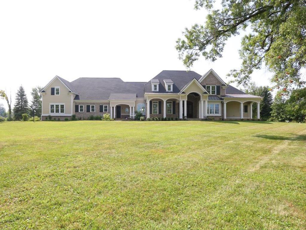 Estate Living at its Finest,4.5 ac,High End Finishes w/Incredible Details Thruout,2 Expansive Coverd Porchs Create The Charm of an Older Home w/The Amenities of a New Home,10' Boxd Beamd Ceils,Stunning Chefs Kit w/Viking Appls,Custm Blt-ins Thruout,3FP,1st Flr Luxury MBR Ste w/His&Her Baths,Huge Mud Rm&Lndry,4BR+Bonus Rm,Unfin Caridge House/4th gar