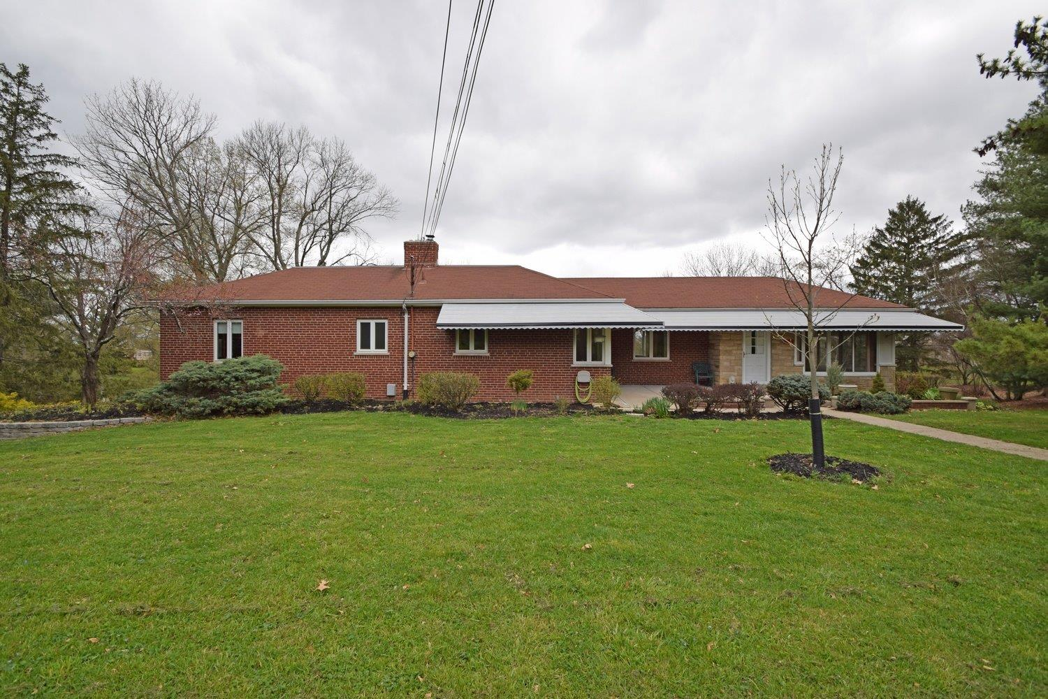 Brick ranch on private lane with park-like setting,.80 acres, pond and wood views, 1 floor living, 1533 SF (county) plus full LL with walk-out, hardwood thru-out,3 season room with grand views, privacy an oasis right near St. X,beautiful setting in the middle of it all,Hdws just refinished.