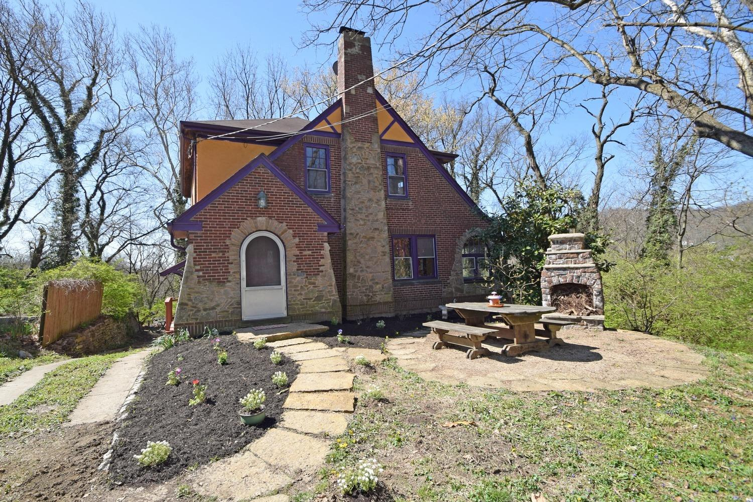 Hard to find Tudor nestled on 2 wooded parcels (1/2 acre total) on quiet cul de sac! Loaded w/ original character, nat'l woodwork, hardwood floors, built-ins. Handsome tile fireplace w/ ornamental + illuminated mantle. Solarium makes an ideal den or office w/ views of Mt Airy Forest + sunsets on the western horizon. Custom patio courtesy HGTV!