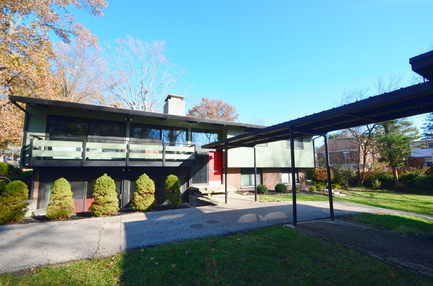 This two level home is unique in that it has a detached 2 car *heated* garage with two bonus rooms on the second floor and a covered walkway to the house.