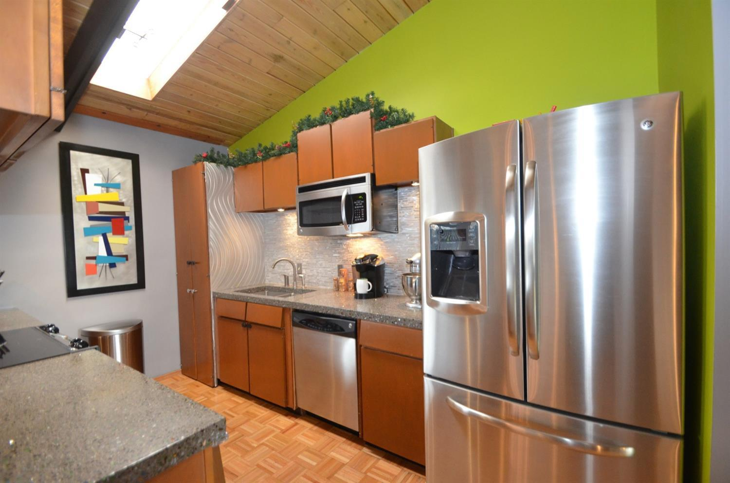 Stainless appliance suite is included in the sale.  Atop the cabinets are custom made concrete counters, with sparkles of crushed (beer bottle) glass!