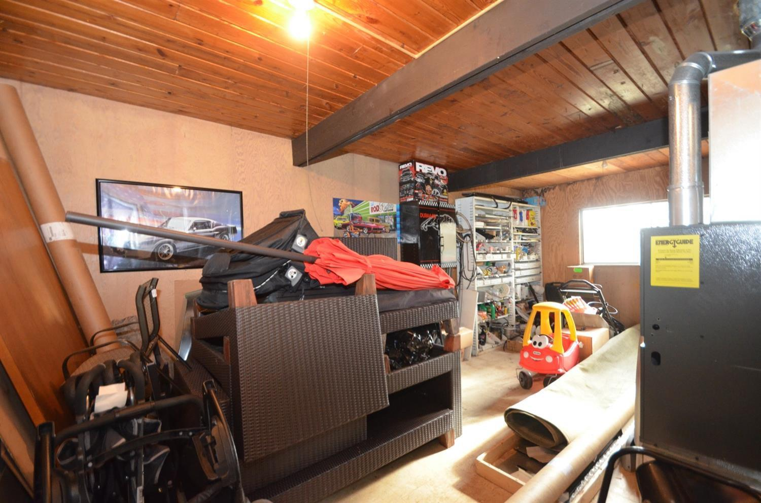 This is the other room on the upper level of the garage.  It was originally office space.  Great bonus finished living space OR  really nice storage space. The garage roof was replaced Summer 2019.  Garage has heat, electric & water.  It also has new gas furnace, new gas line, separate 100 amp electric panel and the foundation has been waterproofed.