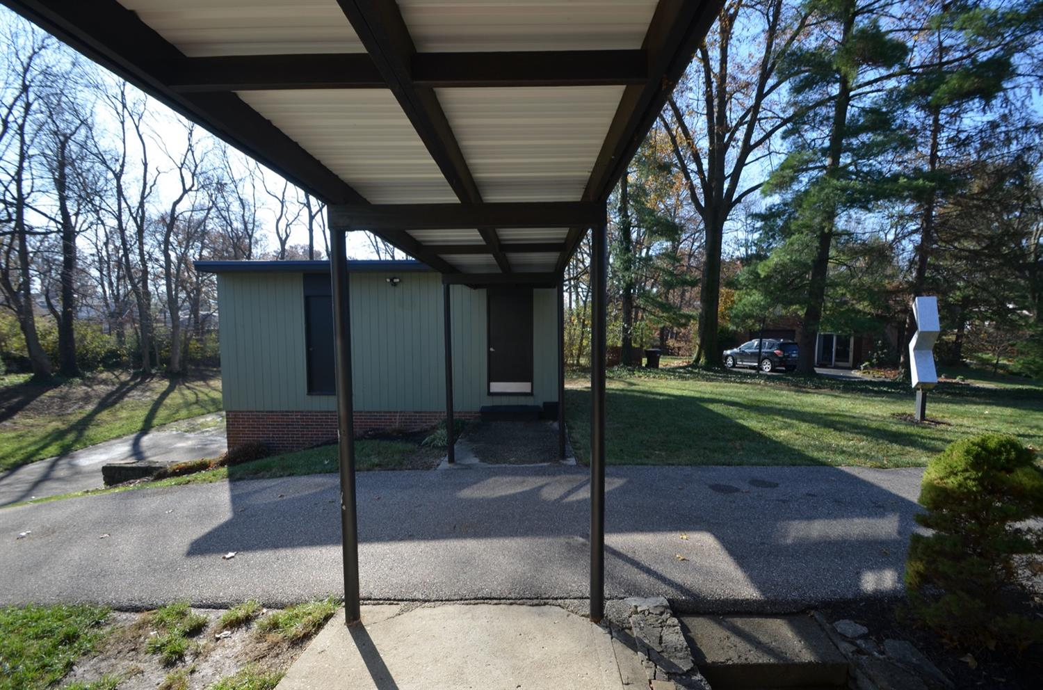 Straight across the covered walkway from the front door is the 2 story garage!