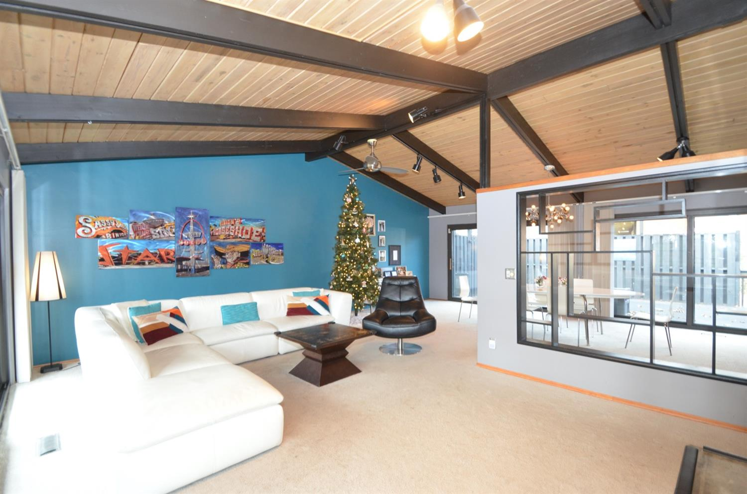 Main level great room is a large living room and dining room with cathedral wood ceiling and wood burning fireplace.