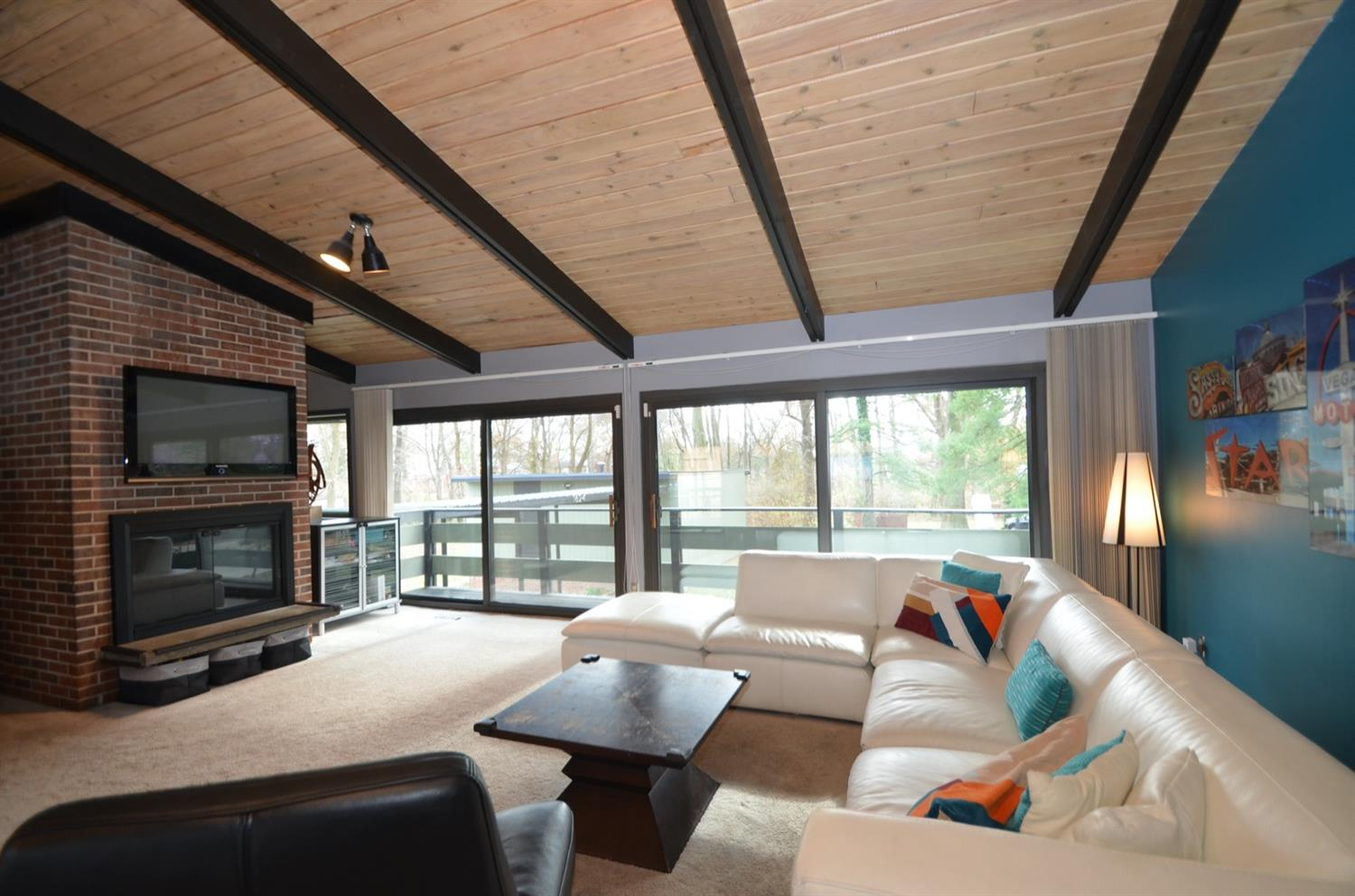Great Room / Living Room with wood burning fireplace and multiple walkouts!