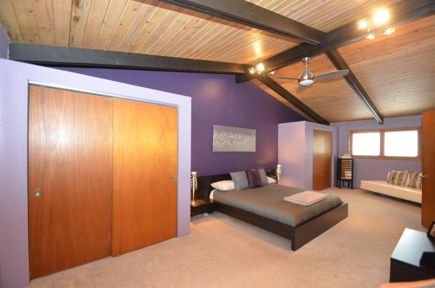 Another view of the 27 ft long master bedroom!  This was originally two smaller bedrooms. Instead of the 4 bedrooms it has now, the house originally had 5!