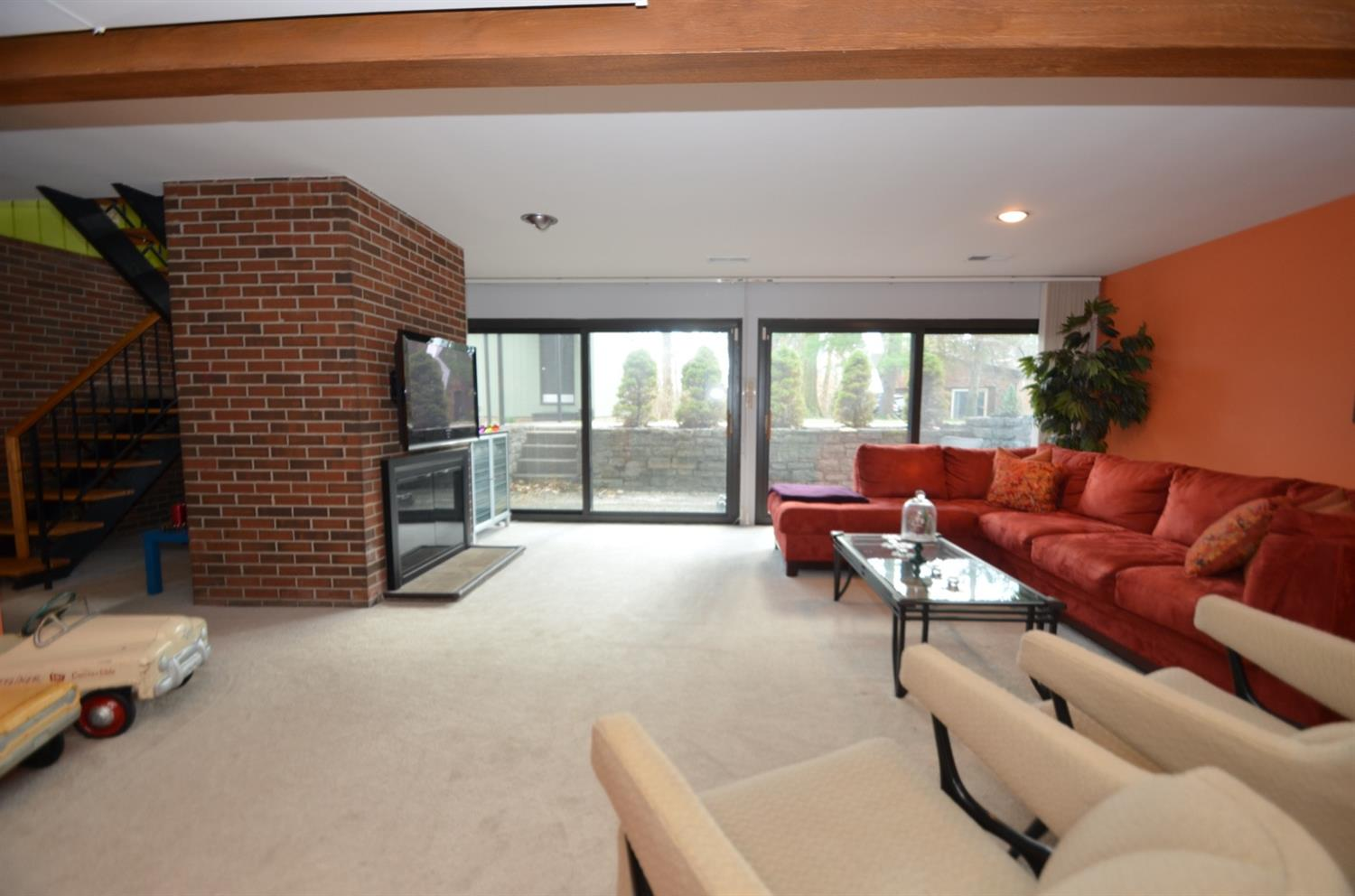 LL family room has another WOOD BURNING FIREPLACE (total of 2) and multiple walkouts to the front patio.