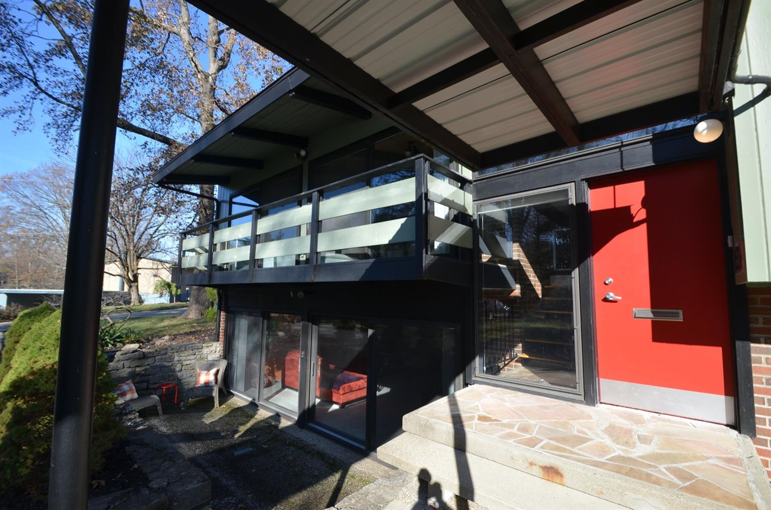 There is no shortage of outdoor living spaces associated with this house.  The LL family room opens to this walled patio, the upper level great room opens to a balcony on this side, and a large deck on the other side.