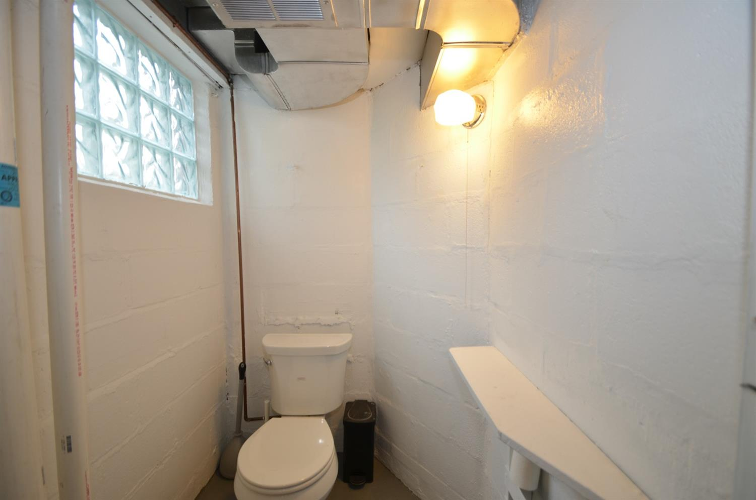 Water closet in separate room, also in the basement.  There are a total of 2.5 baths in the house.