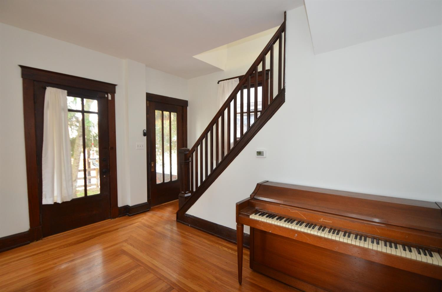 Check out these great Craftsman details and the original picture frame floors.
