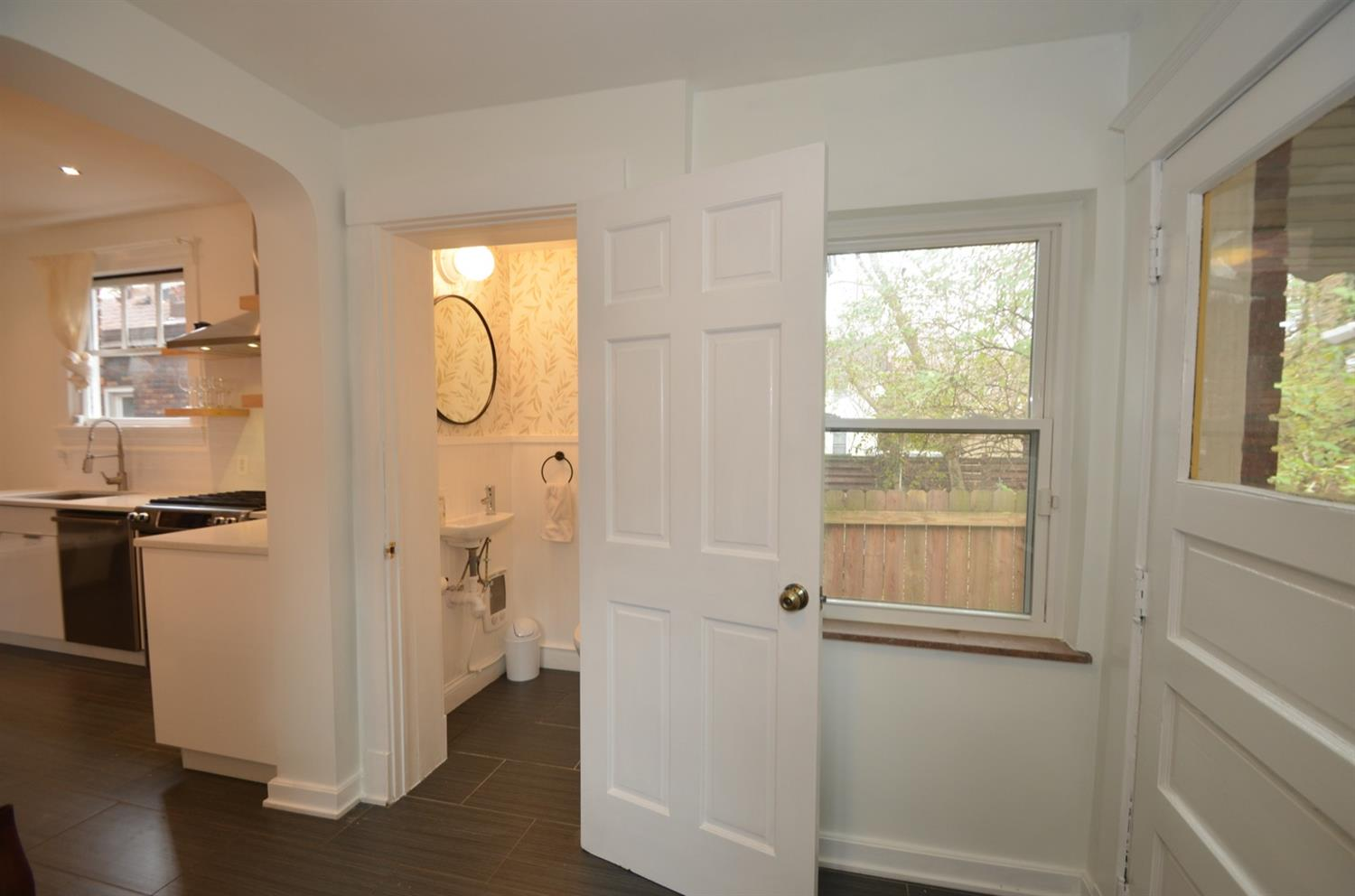 And between the mudroom and the kitchen is this NEW powder room!