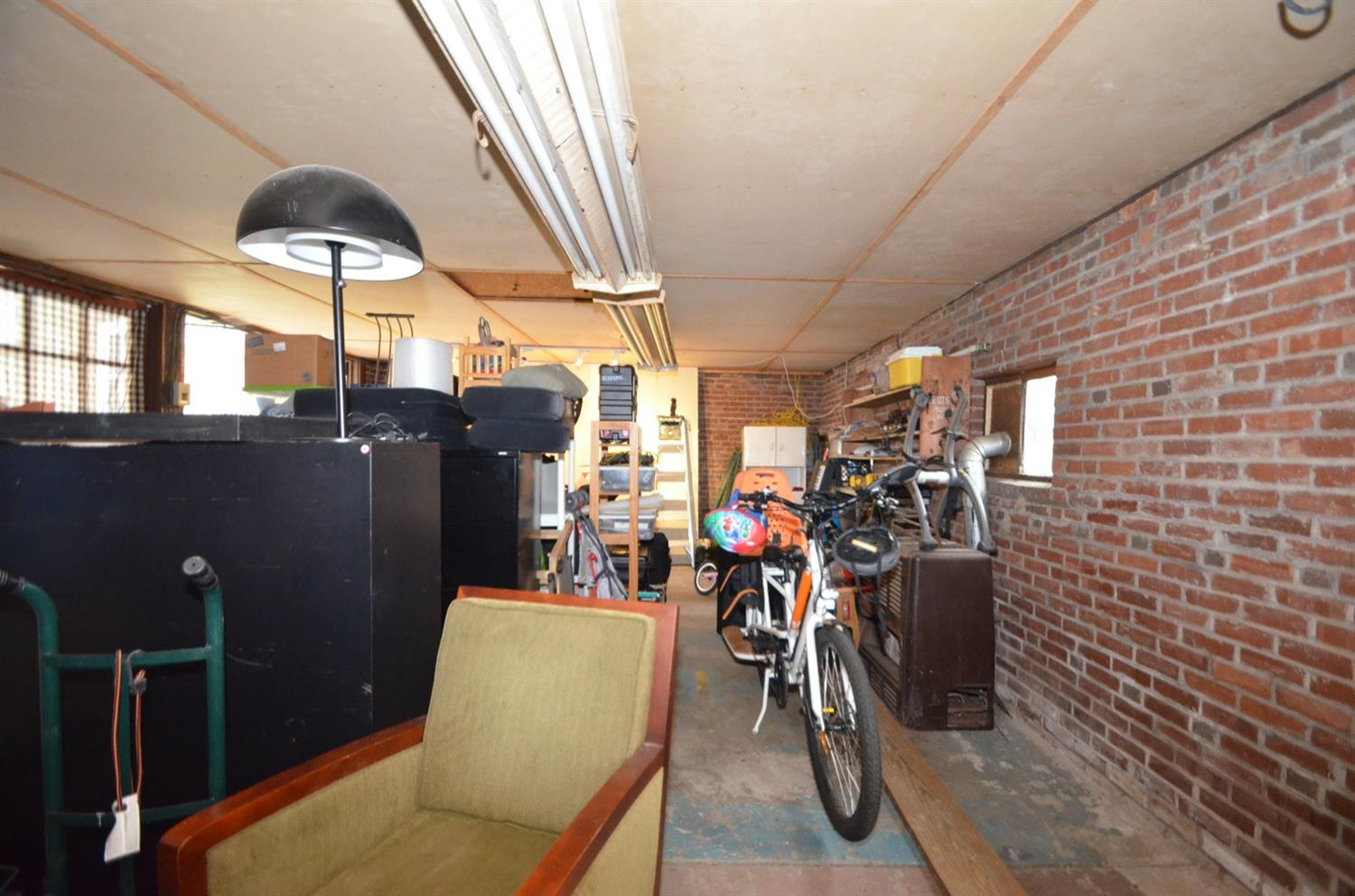 This is inside the garage, which is currently being used for storage.  Building has electric. Heater/furnace is included, but has never been used by current owner and is not warranted. Garage sold as is, but it's so cool!