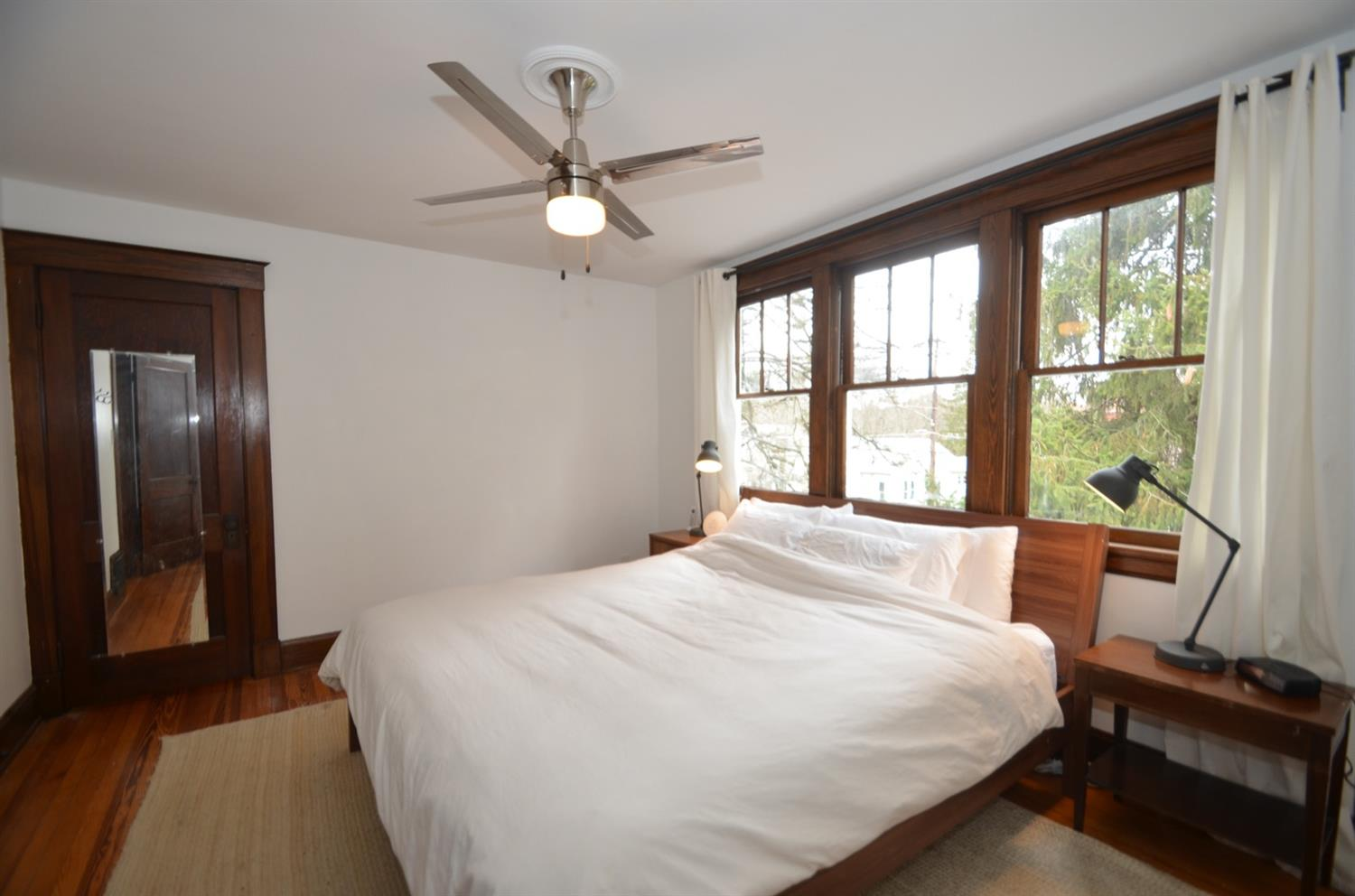 Large master bedroom has a wall of windows and an oversized closet.