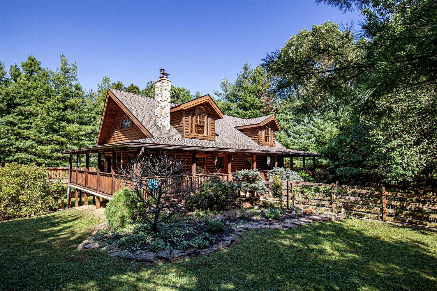 Your own mountain retreat without leaving Cincinnati! Secluded, pristine log cabin home, heavily wooded lot! Gleaming hardwood flooring & open floor plan add to the allure. two story great room with stone fireplace leads to kitchen w/granite counters, counter bar, island. Master suite is one of biggest you'll find! Finished LL w/walk-out.
